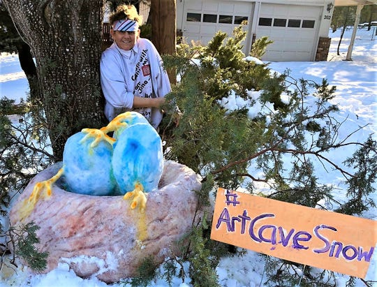 Artist Jana Lynch couldn't finish her snow creation, because the temperature rose.
