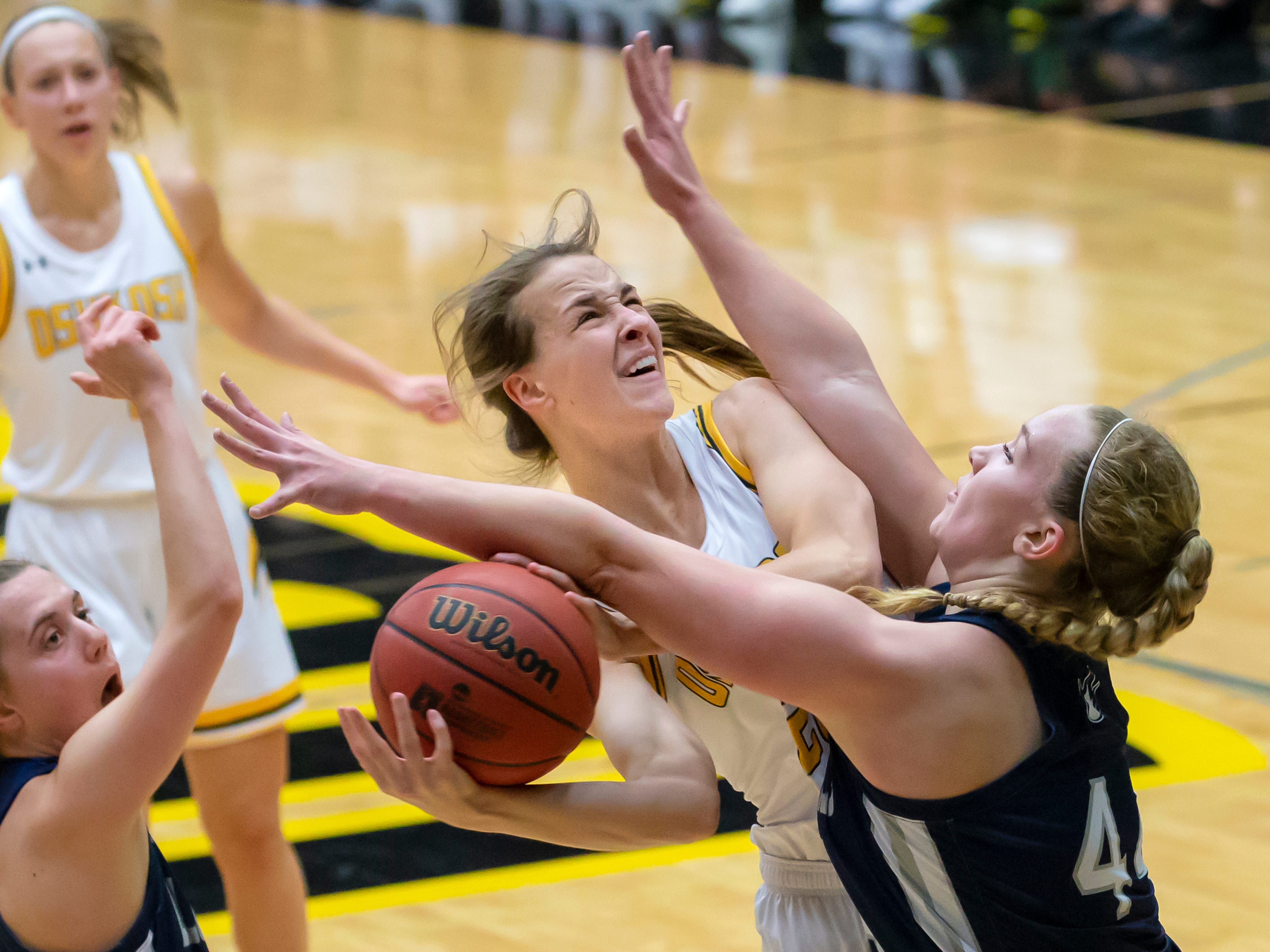 UW-Stout's Emily Jacques (hometown Oshkosh) blocks the shot attempt by UW-Oshkosh's Jessie Rabas (hometown De Pere) at the Kolf Sports Center on Saturday, January 5, 2019.