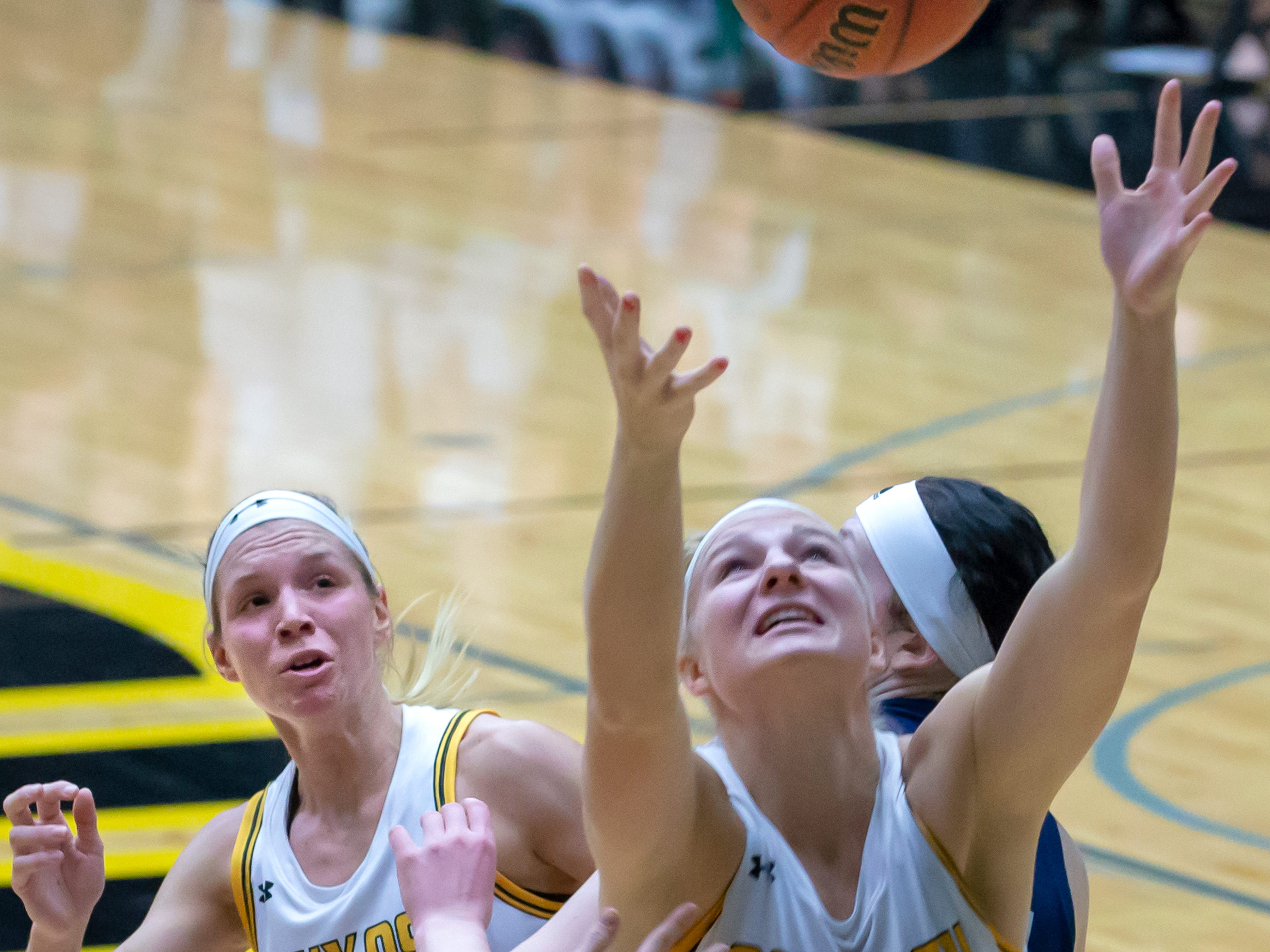 UW-Oshkosh's Erin Vande Zande looks to grab the rebound at the Kolf Sports Center on Saturday, January 5, 2019.