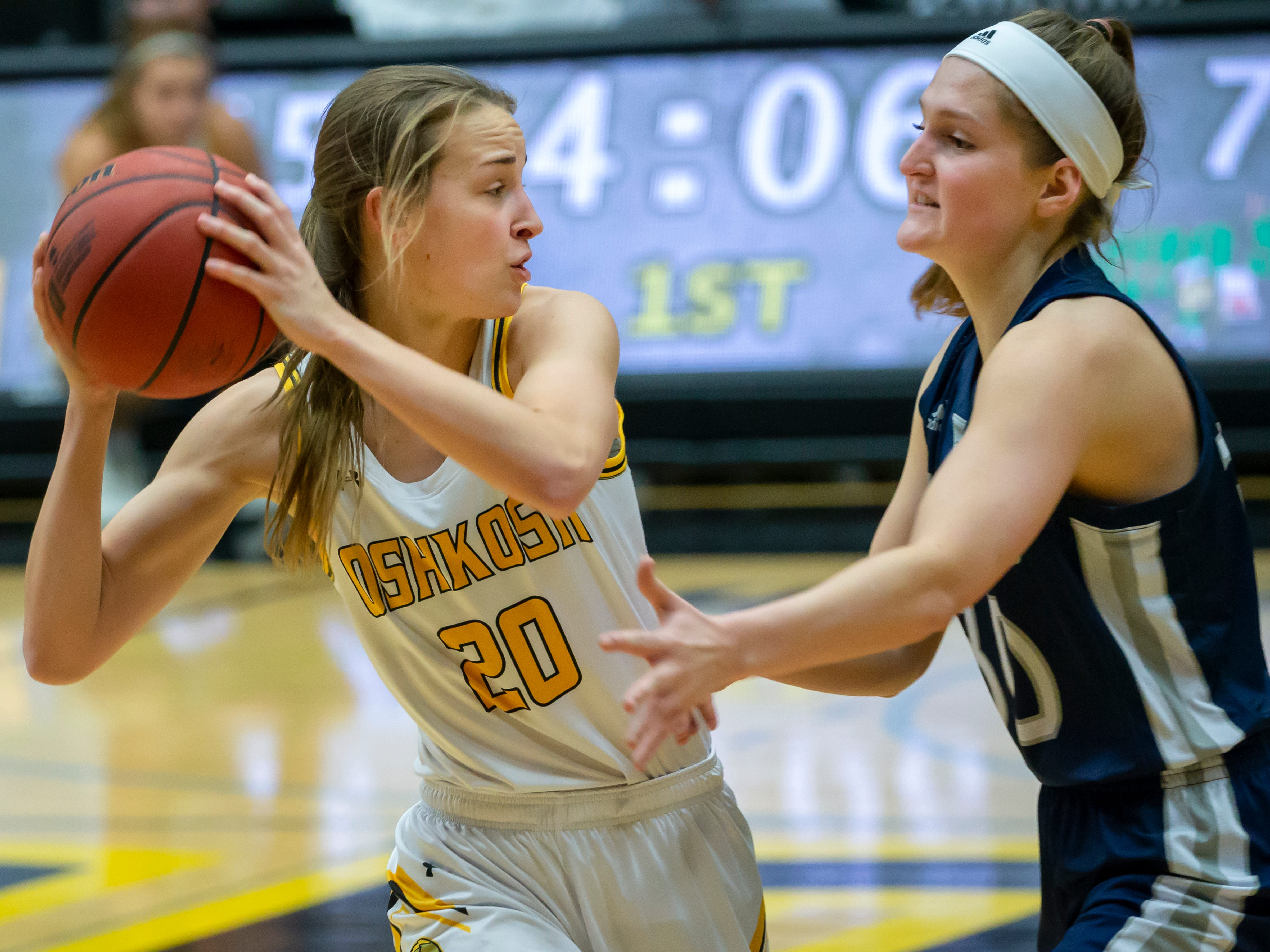 UW-Oshkosh's Jessie Rabas protects possession from UW-Stout's Carolyn Feddema at the Kolf Sports Center on Saturday, January 5, 2019.