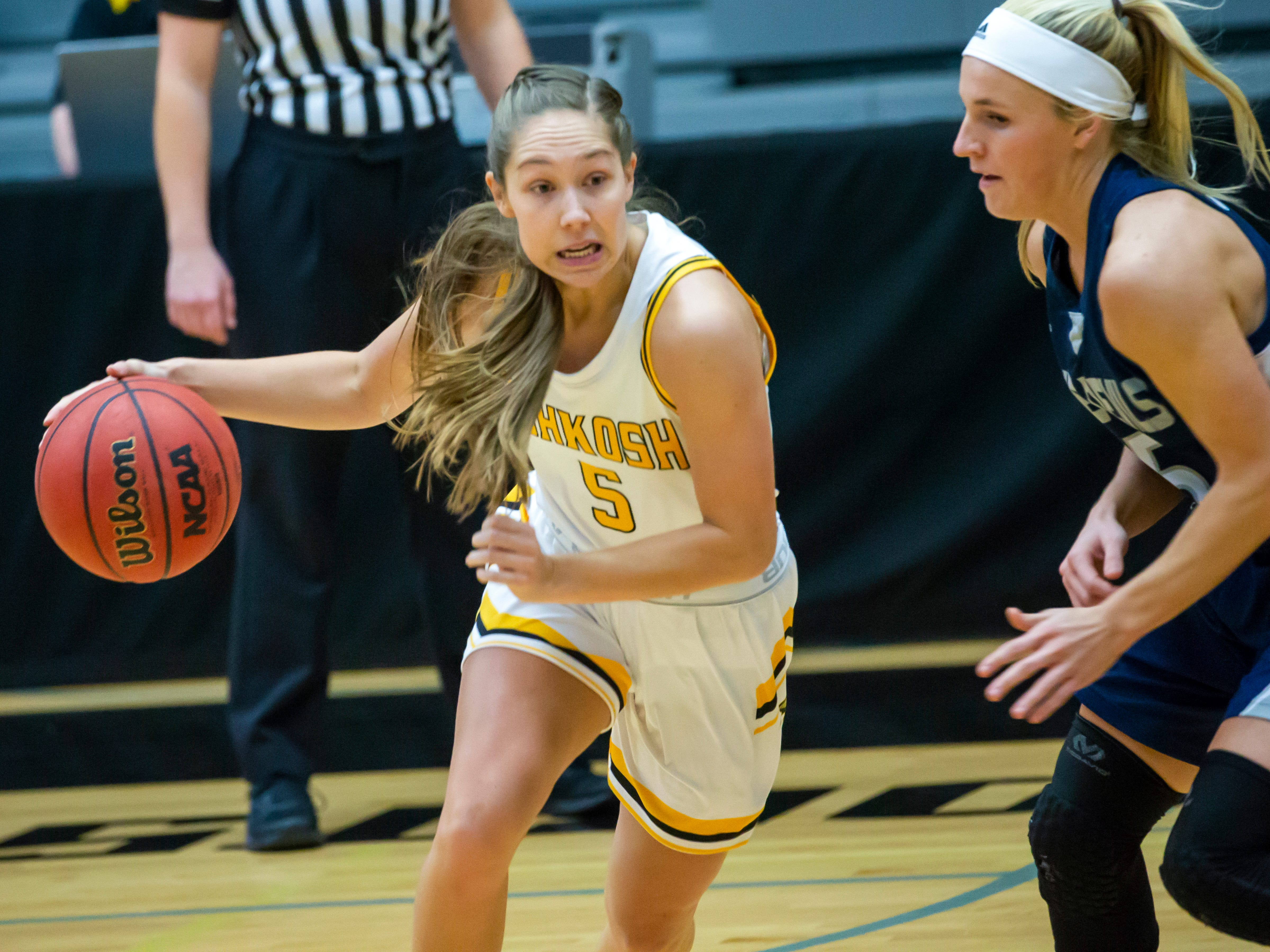 UW-Oshkosh's Chloe Pustina drives the ball around UW-Stout's Kyncaide Diedrich at the Kolf Sports Center on Saturday, January 5, 2019.