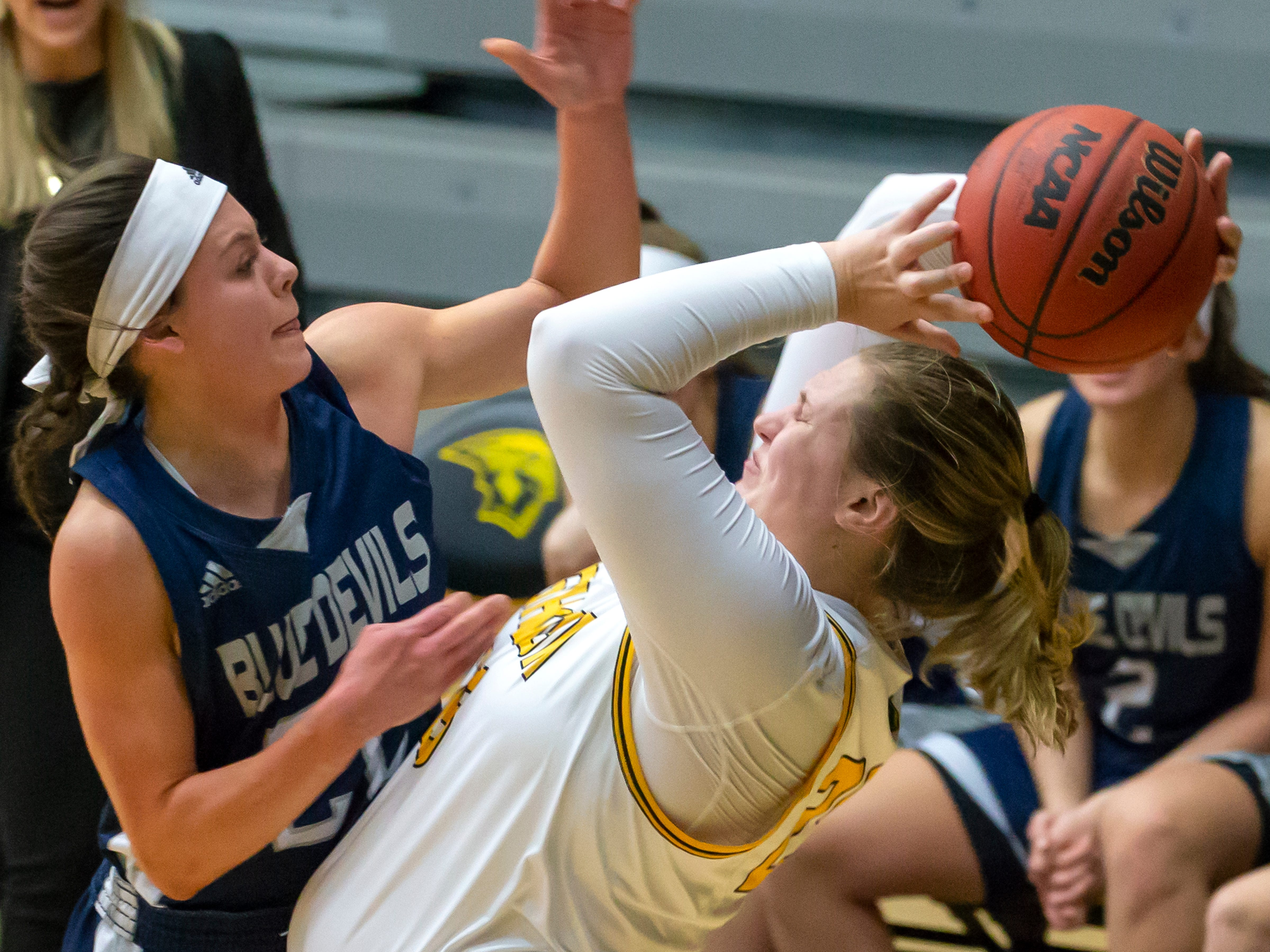 UW-Stout's Bailey Diersen attempts to break the ball from UW-Oshkosh's Karsyn Rueth at the Kolf Sports Center on Saturday, January 5, 2019.