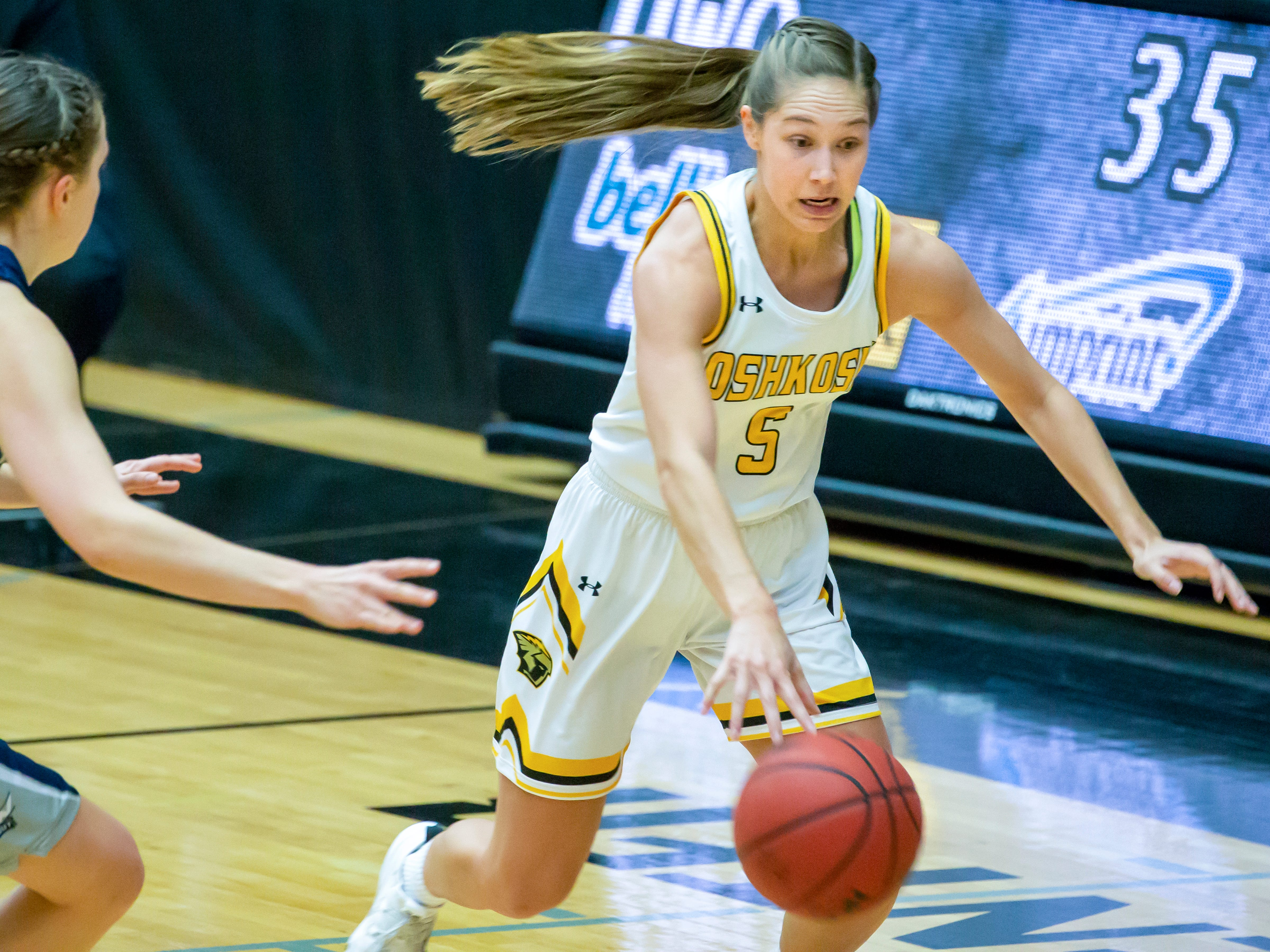 UW-Oshkosh's Chloe Pustina drives the ball across the court playing against UW-Stout at the Kolf Sports Center on Saturday, January 5, 2019.