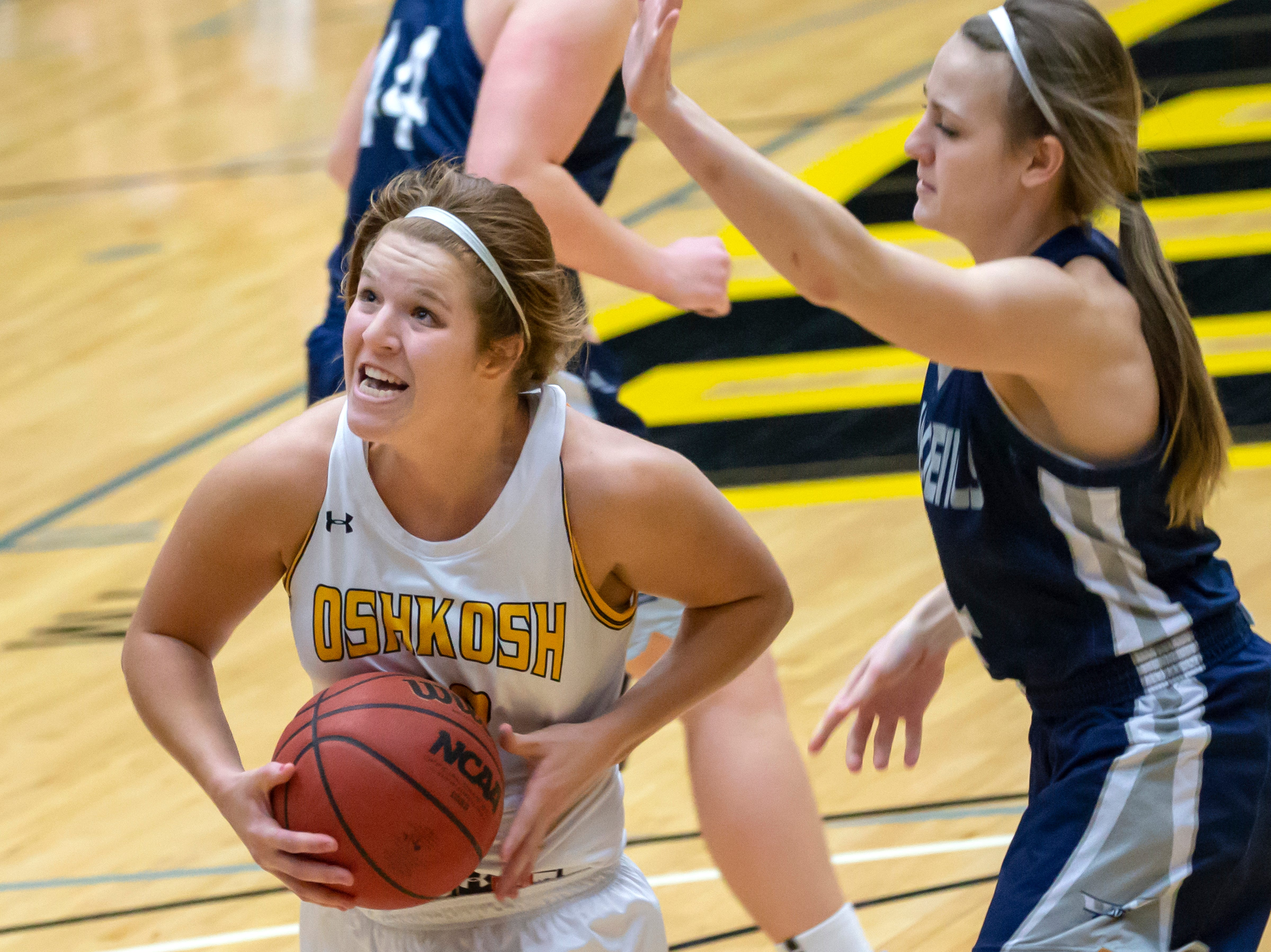 UW-Oshkosh's Nikki Arneson drives to the basket past UW-Stout's Becky Fesenmaier at the Kolf Sports Center on Saturday, January 5, 2019.
