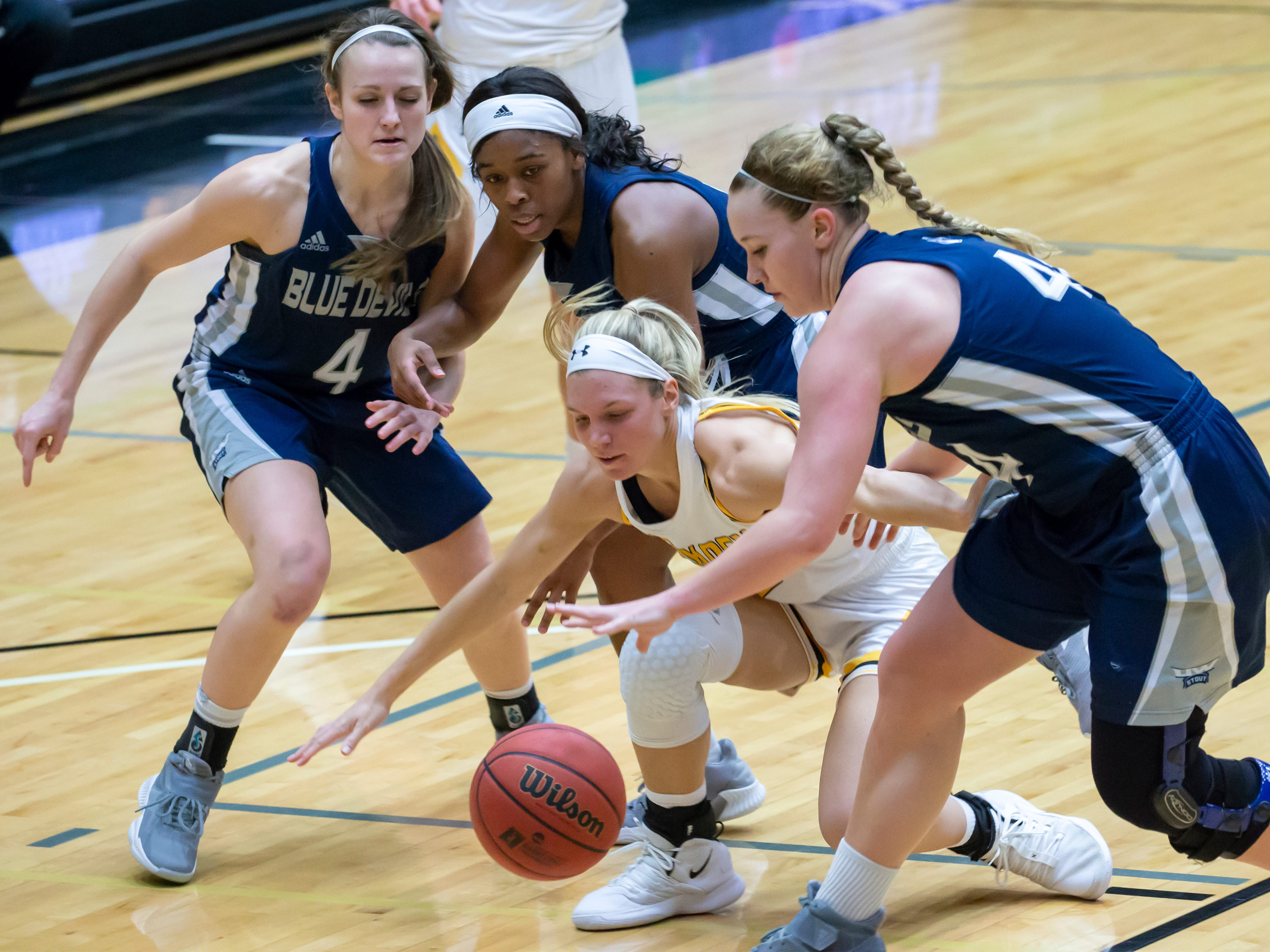 UW-Oshkosh's Melanie Schneider and UW-Stout players go after the loose ball at the Kolf Sports Center on Saturday, January 5, 2019.