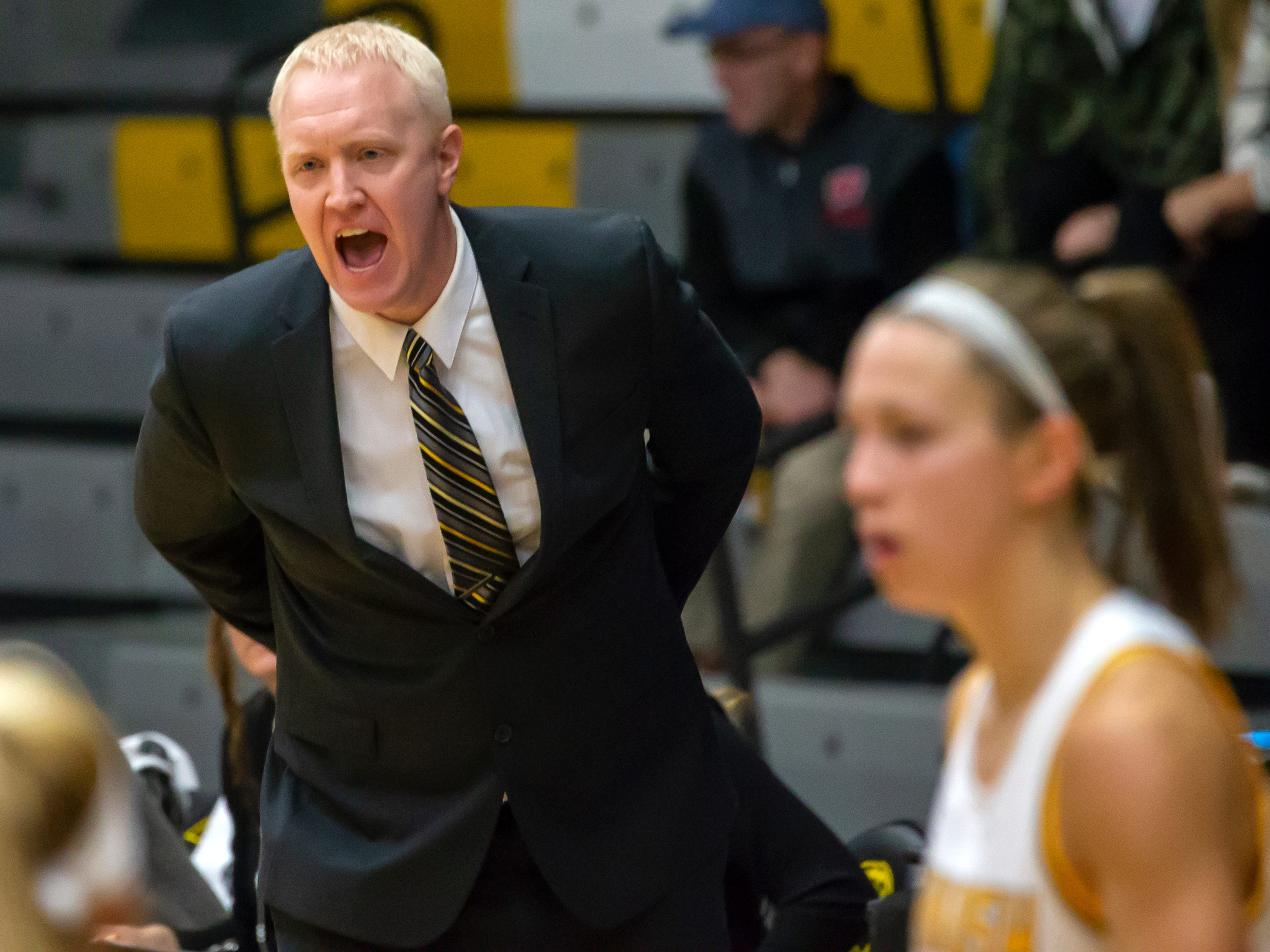 UW-Oshkosh head coach Brad Fischer directs the players on the court at the Kolf Sports Center on Saturday, January 5, 2019.