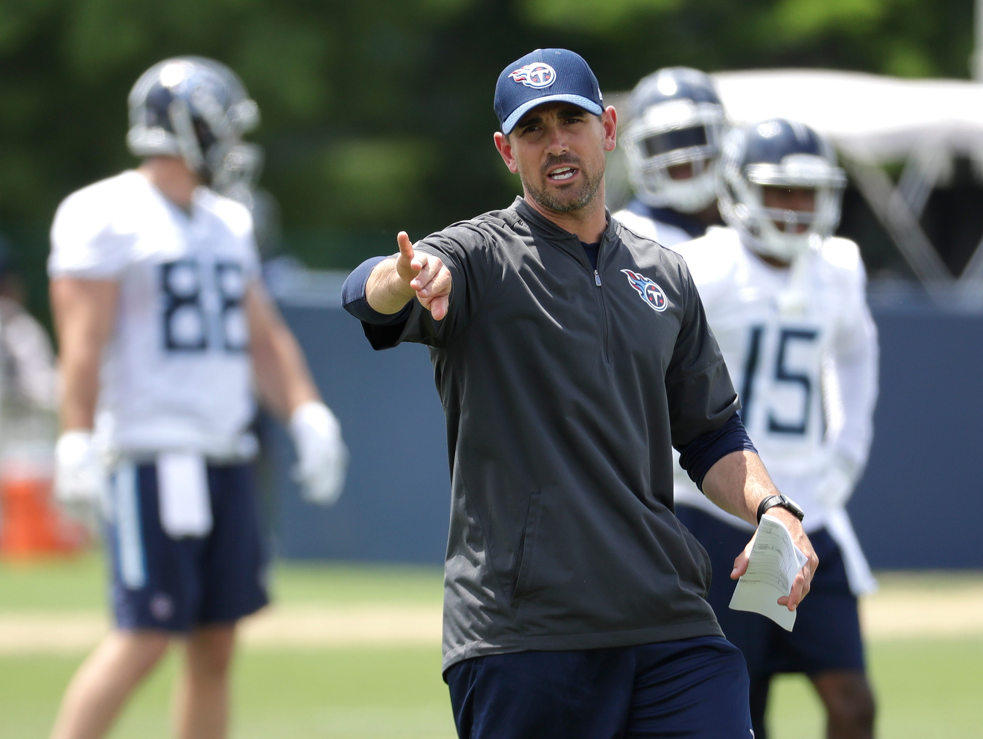 Tennessee Titans offensive coordinator Matt LaFleur runs a drill during an organized team activity at the Titans' NFL football training facility Tuesday, May 22, 2018, in Nashville, Tenn. (AP Photo/Mark Humphrey)