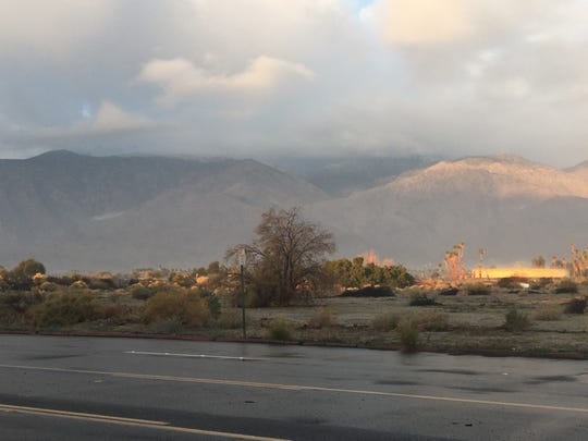 Clouds hover above the San Jacinto Mountains near Palm Springs Sunday after a passing storm dropped as much as 0.25 inches of rain on parts of the city.
