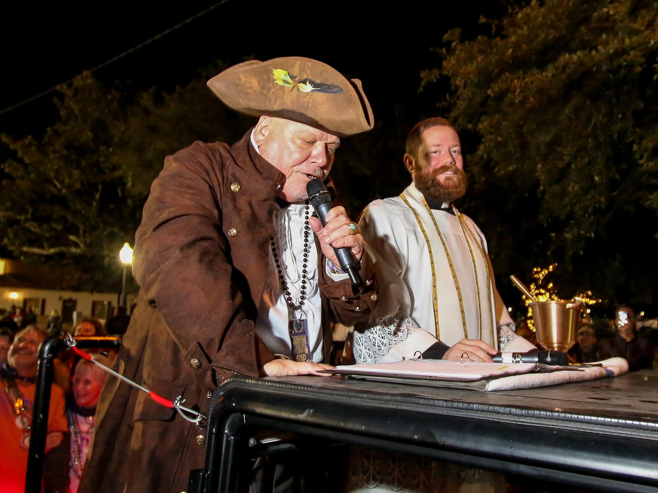 T. Bubba Bechtol, left, announces a krewe before The Reverend Nicholas Schumm blesses the krewe's float during the 2019 Pensacola Mardi Gras season kickoff celebration in downtown on Saturday, January 5, 2019.
