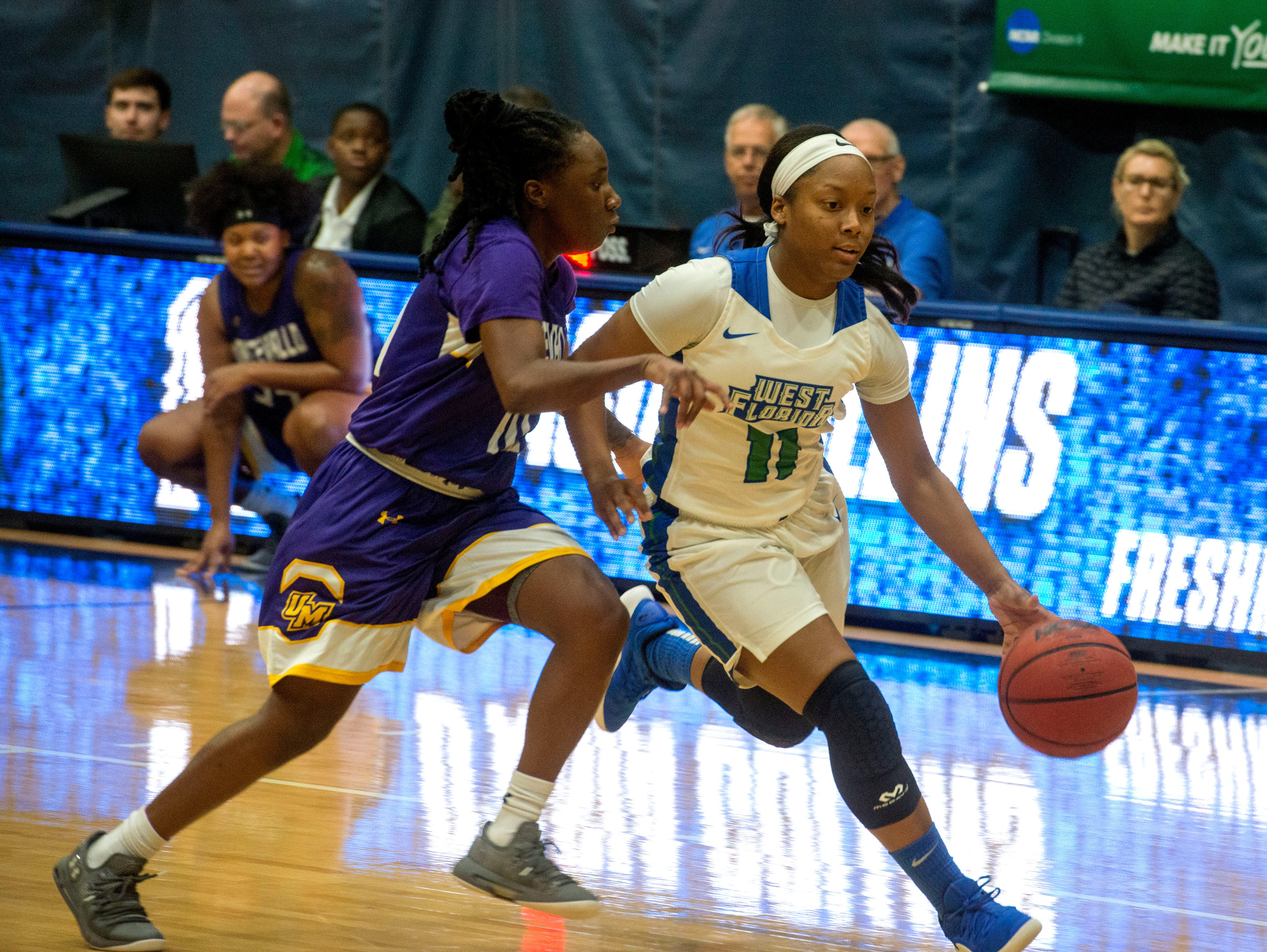 West Florida's D'Asia Collins drives to the basket as they take on the Montevallo Falcons Saturday, January 5, 2019 at the UWF Field House