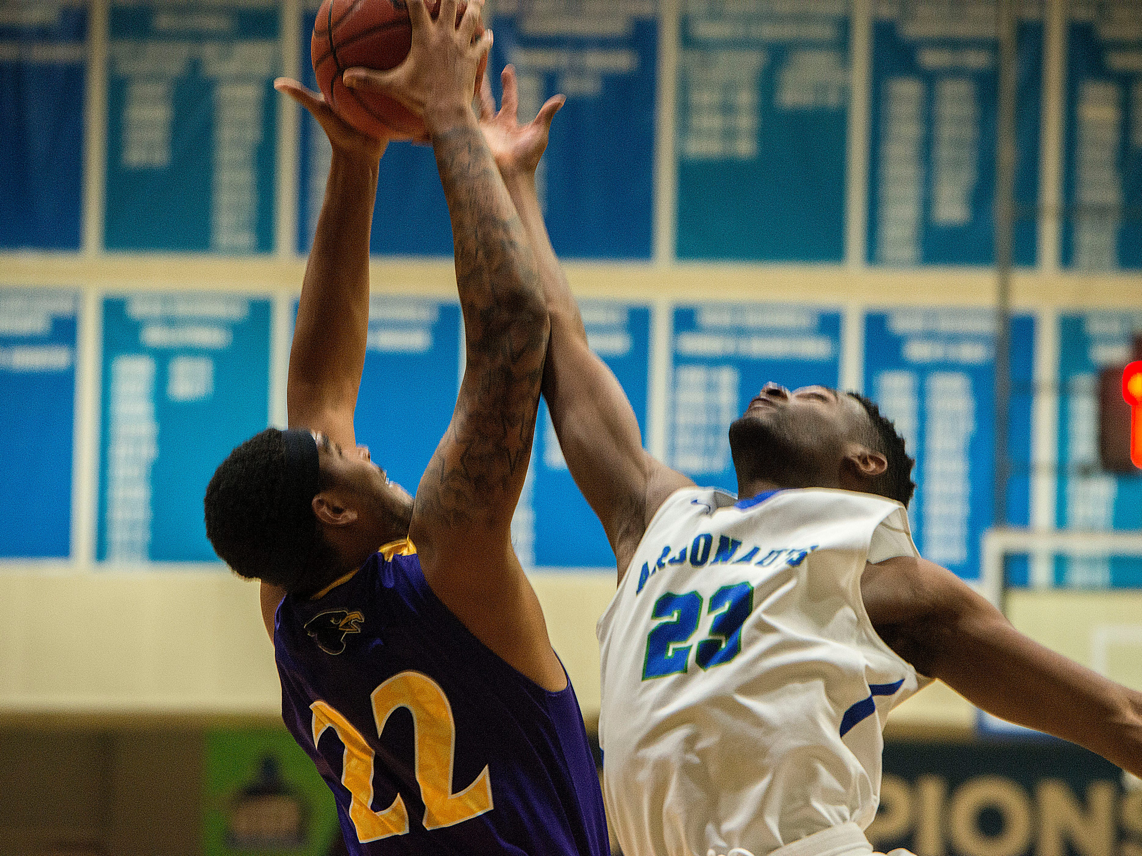 Montevallo's Jeremiah Curtis (22) and West Florida's Jarrett Henderson go up for the ball as they take on the Montevallo Falcons Saturday, January 5, 2019 at the UWF Field House