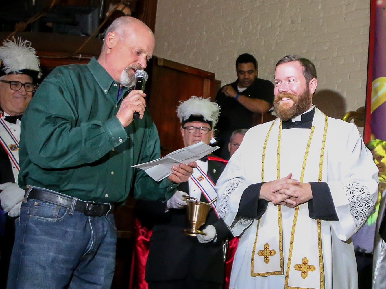 Danny Zimmern, president of Pensacola Mardi Gras, Inc., left, introduces The Reverend Nicholas Schumm at Seville Quarter during the 2019 Pensacola Mardi Gras season kickoff celebration on Saturday, January 5, 2019.