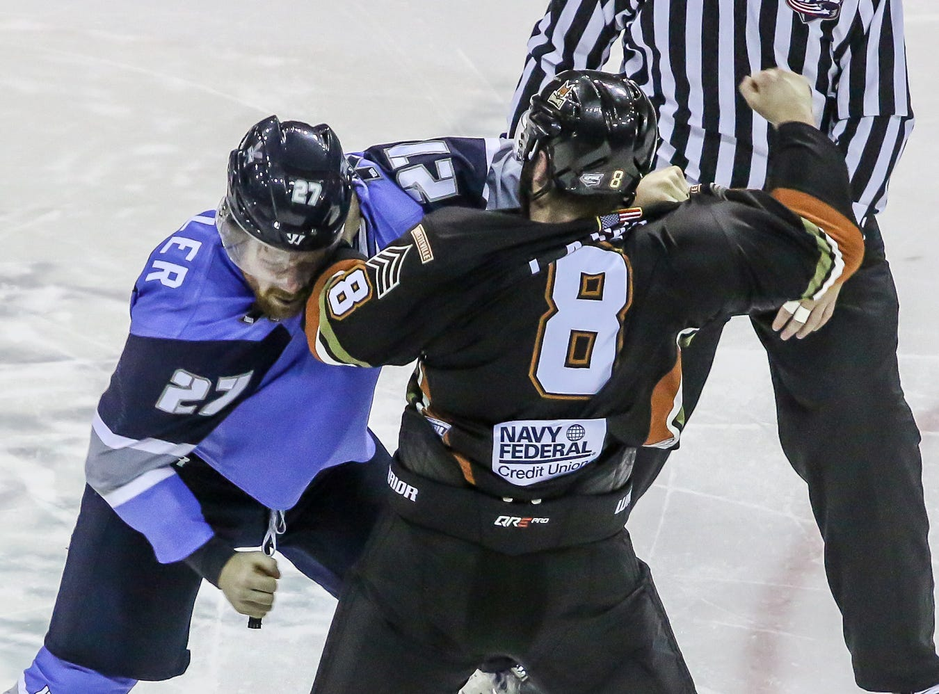 Pensacola's Jesse Kessler (27) and Fayetteville's Michael Casale (8) fight during the third period of the game at the Pensacola Bay Center on Saturday, January 5, 2019.