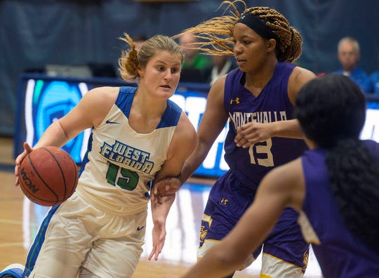 West Florida's Danielle Norquest drives to the basket as they take on the Montevallo Falcons Saturday, January 5, 2019 at the UWF Field House