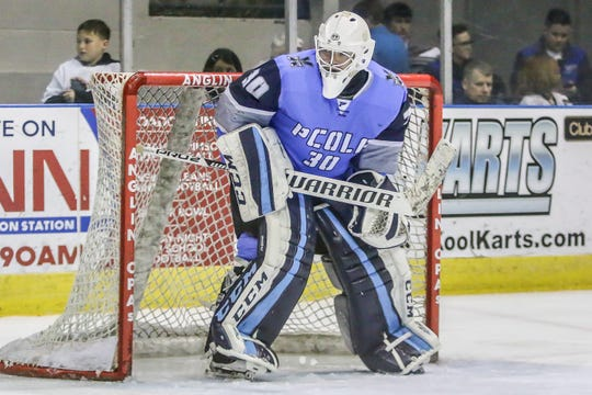 Pensacola goalie Brian Billett (30) watches as a teammate starts to clear the puck from the Ice Flyers' zone against Fayetteville at the Pensacola Bay Center on Saturday, January 5, 2019.