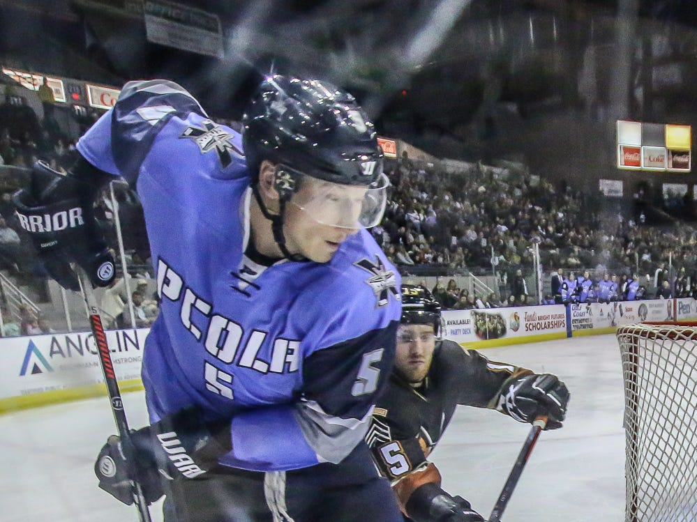 Pensacola's Carter Struthers (5) works the puck against the boards to keep Fayetteville's Taylor Pryce (15) from it at the Pensacola Bay Center on Saturday, January 5, 2019.