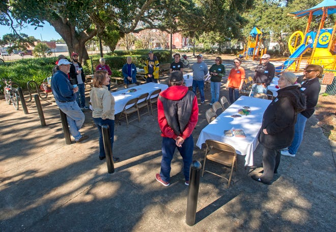 People enjoy each others company Saturday, December 5, 2019 during the Belmont-DeVilliers Neighborhood Association's community party at Henry T. Wyer Park.