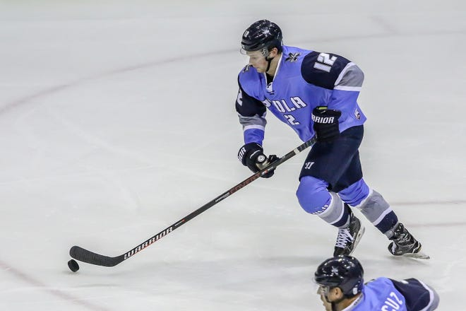 Pensacola's Tim Moore (12) works to get control of the puck as he skates up the ice against Fayetteville at the Pensacola Bay Center on Saturday, January 5, 2019.