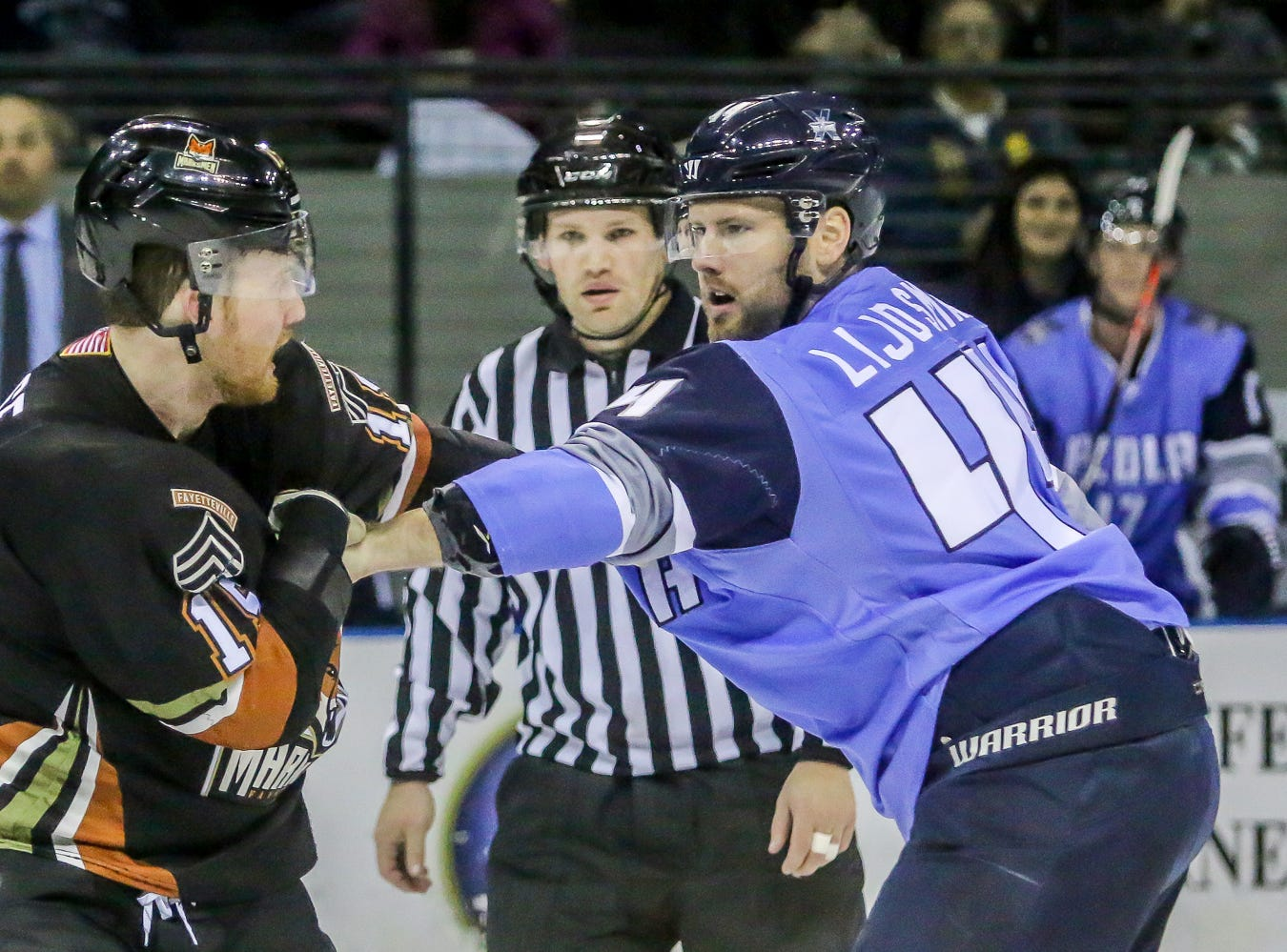 Pensacola's Chris Lijdsman (44) and Fayetteville's Taylor Pryce (15) punch it out during the third period of the game at the Pensacola Bay Center on Saturday, January 5, 2019.