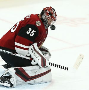 Arizona Coyotes goalie Darcy Kuemper (35) blocks a shot by the New Jersey Devils in the third period on Jan. 4 at Gila River Arena.