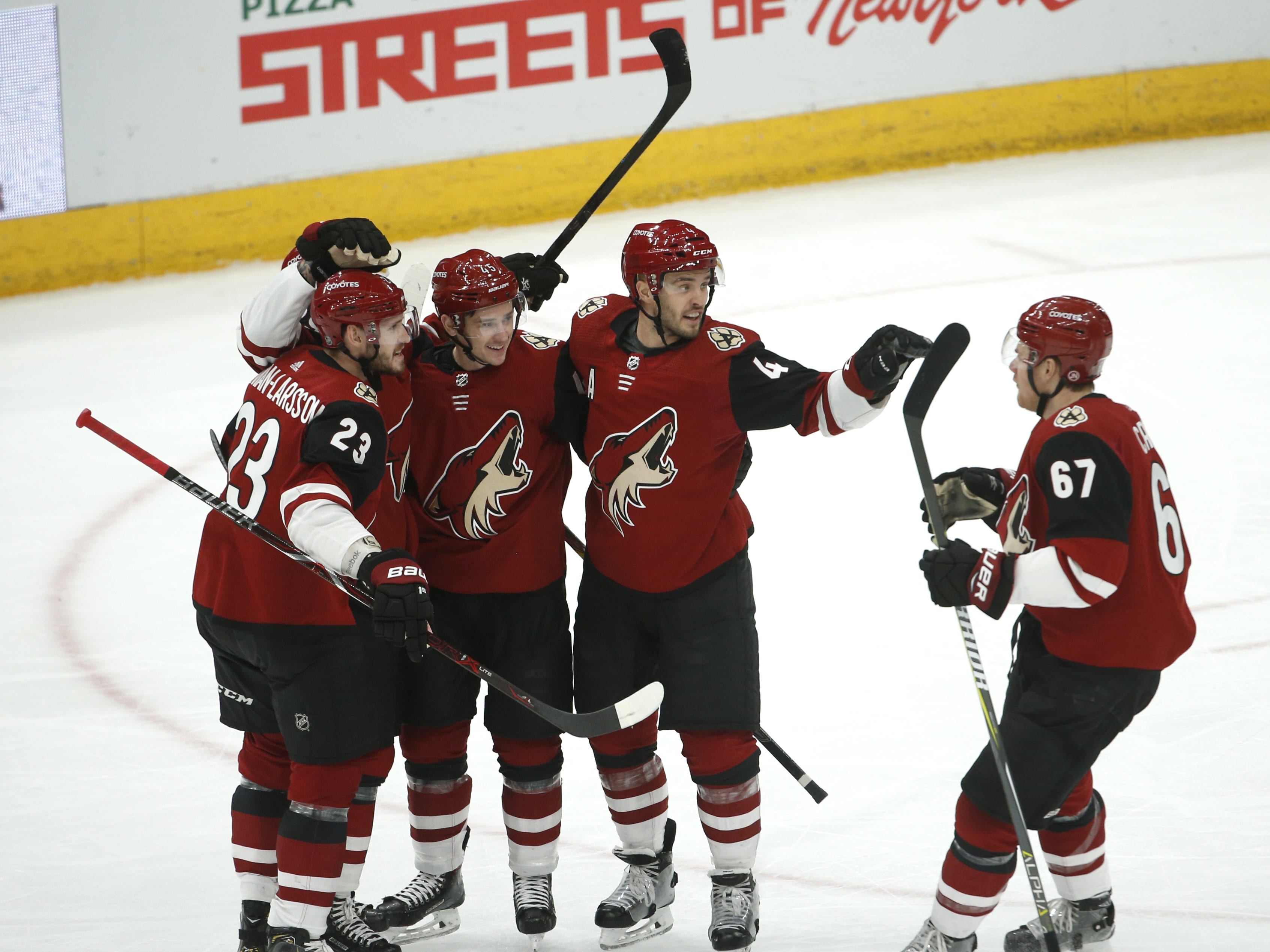 Coyotes' Mario Kempe (29) celebrates scoring with his teammates during the first period against the Rangers at Gila River Arena in Glendale, Ariz. on January 6, 2019.