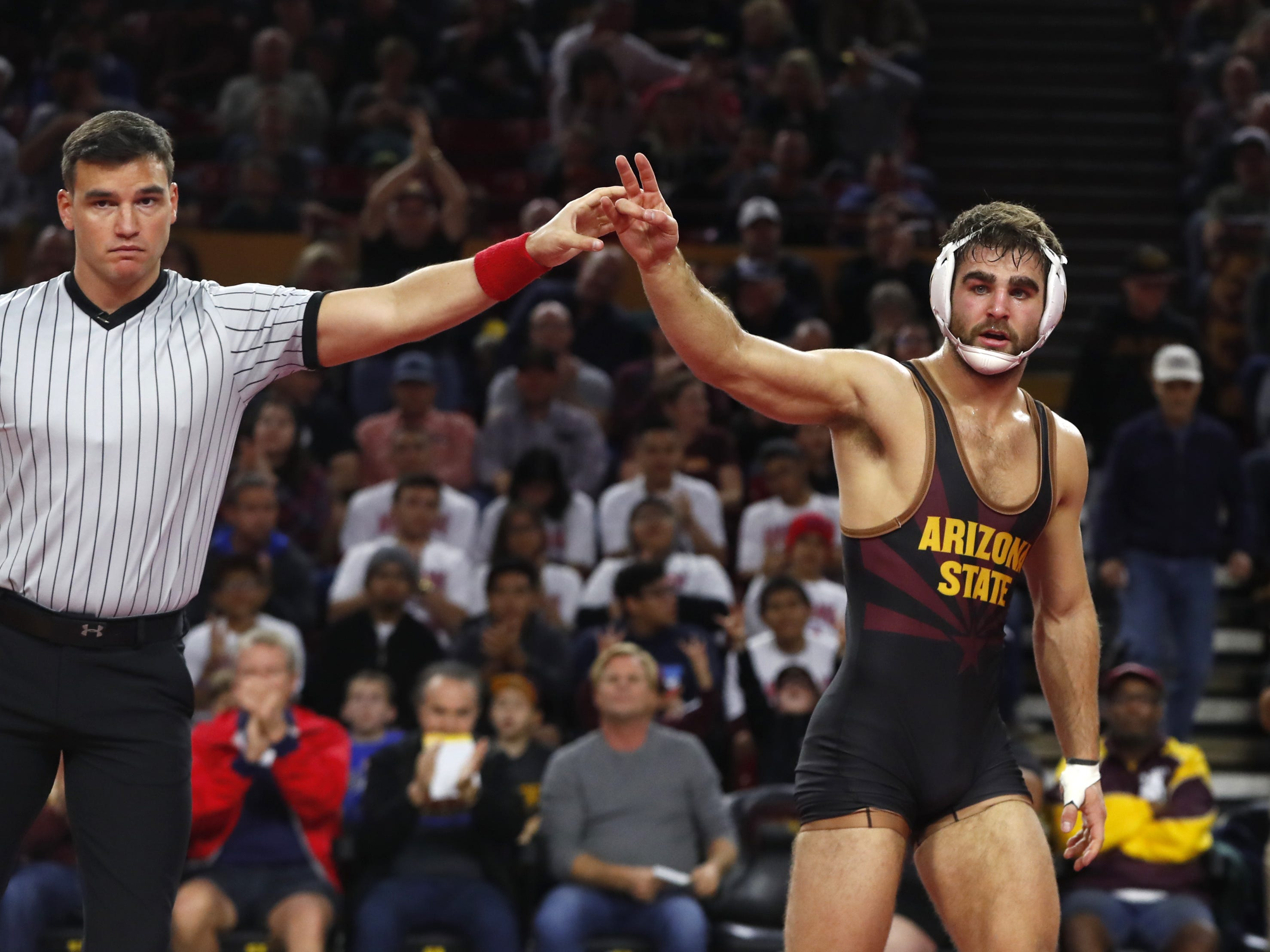 ASU's Josh Shields (in black) wins over Michigan's Logan Massa (in yellow and blue) during a 165 lbs match at Wells Fargo Arena in Tempe, Ariz. on January 5, 2019.