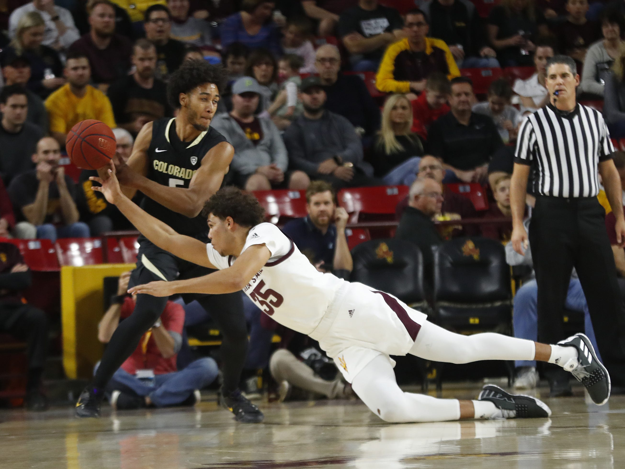 ASU's Taeshon Cherry (35) dives forcing a steal on Colorado's D'Shawn Schwartz (5) during the first half at Wells Fargo Arena in Tempe, Ariz. on January 5, 2019.
