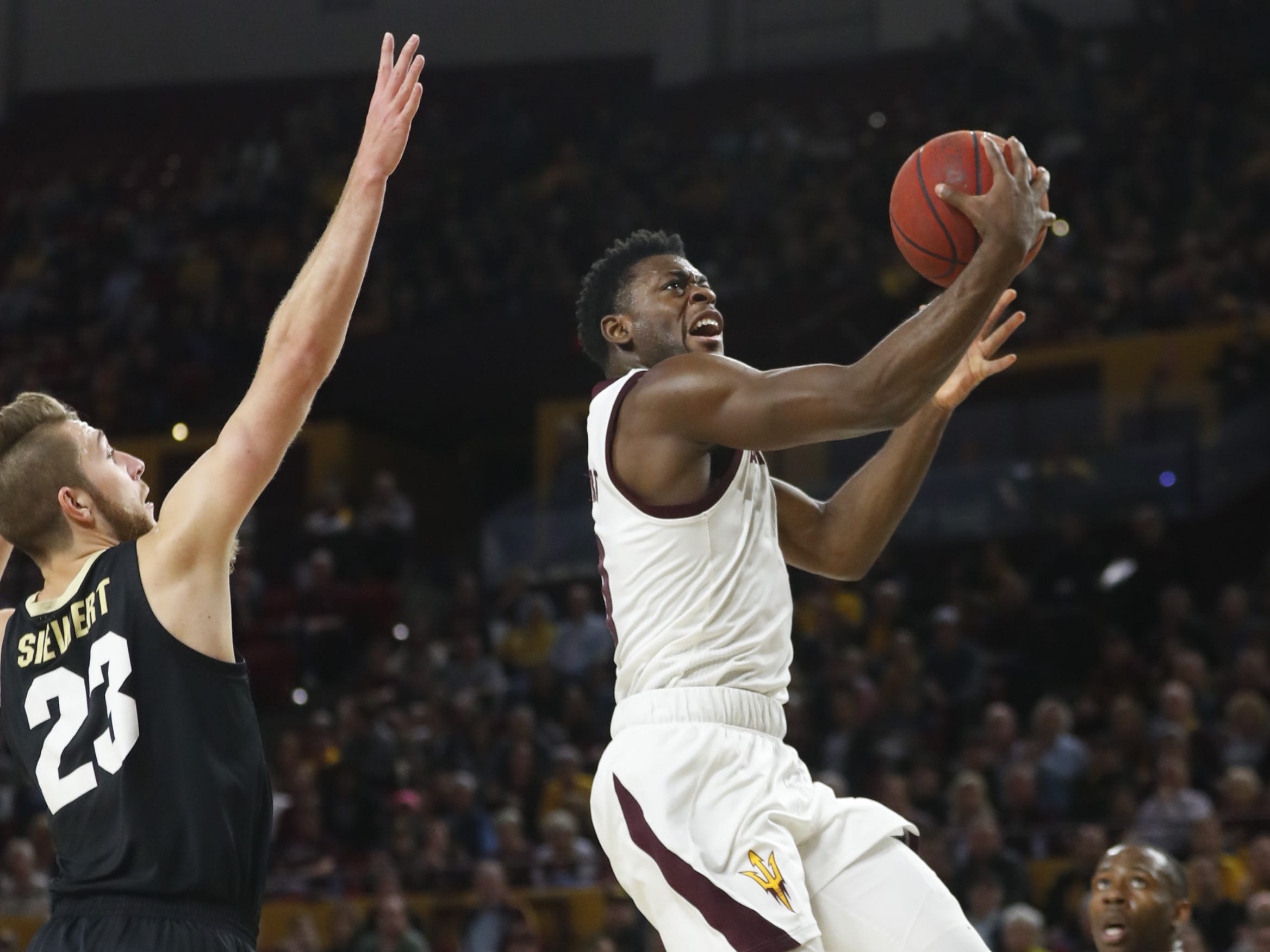 ASU's Luguentz Dort (0) makes a layup against Colorado's Lucas Siewert (23) during the first half at Wells Fargo Arena in Tempe, Ariz. on January 5, 2019.