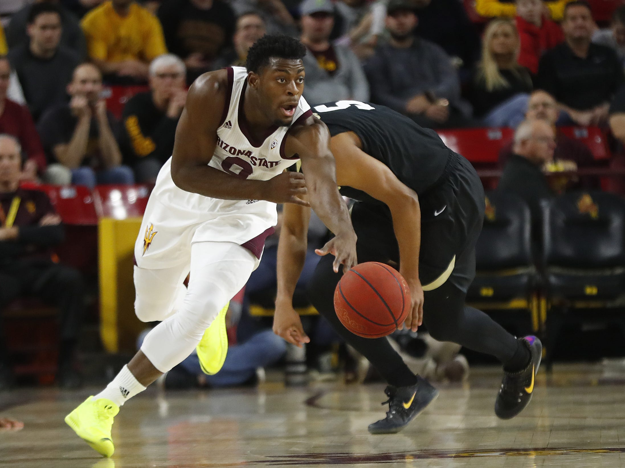 ASU's Luguentz Dort (0) grabs a steal on Colorado's D'Shawn Schwartz (5) during the first half at Wells Fargo Arena in Tempe, Ariz. on January 5, 2019.