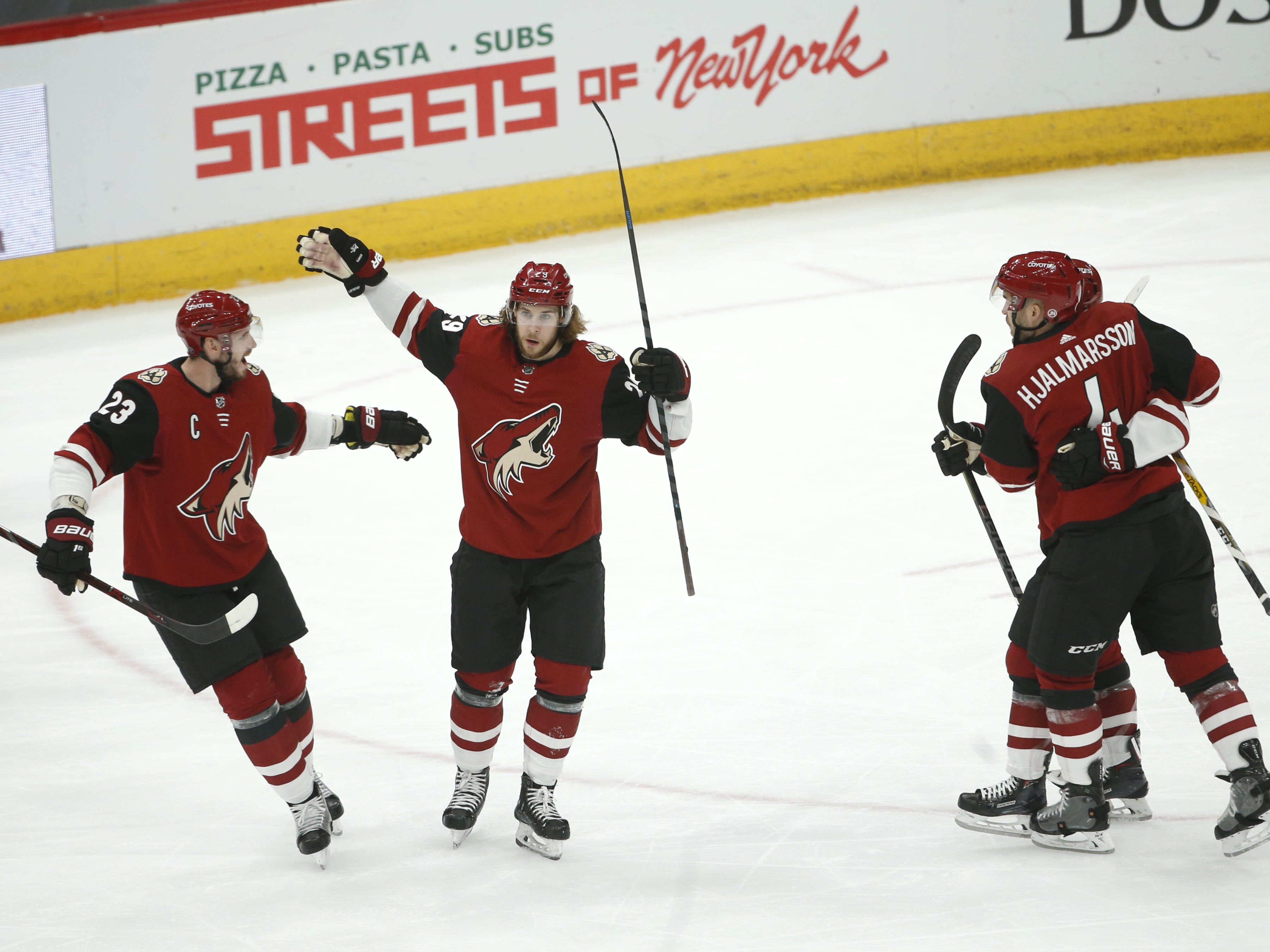 Coyotes' Mario Kempe (29) celebrates scoring with Oliver Ekman-Larsson (23) during the first period against the Rangers at Gila River Arena in Glendale, Ariz. on January 6, 2019.