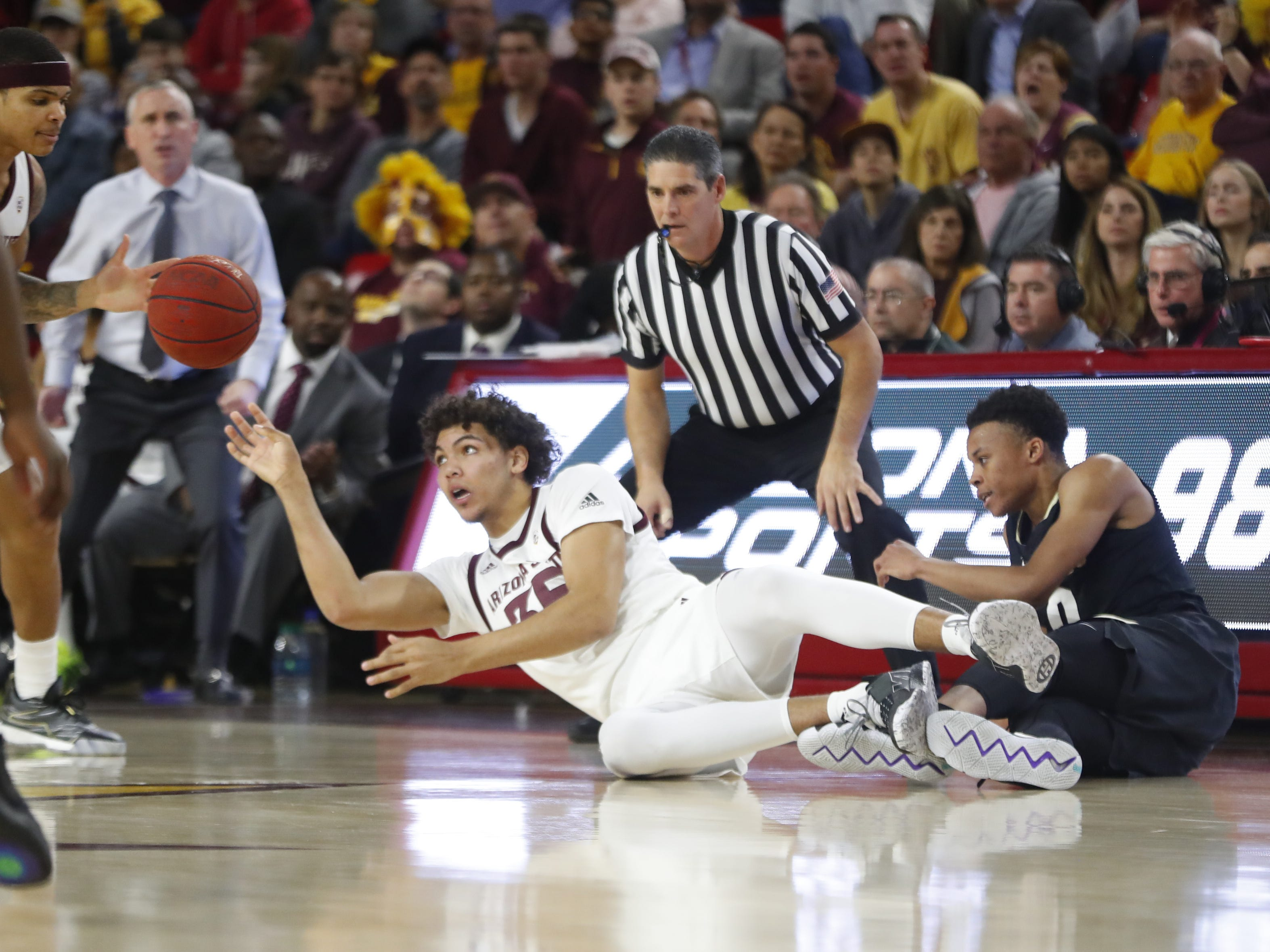 ASU's Taeshon Cherry (35) passes from the floor after grabbing a steal against Colorado's Shane Gatling (0) during the first half at Wells Fargo Arena in Tempe, Ariz. on January 5, 2019.