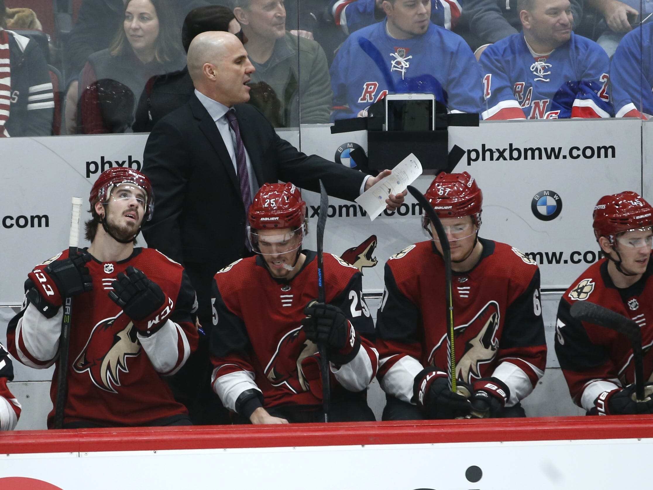 Coyotes' head coach Rick Tocchet talks with his team during the first period against the Rangers at Gila River Arena in Glendale, Ariz. on January 6, 2019.