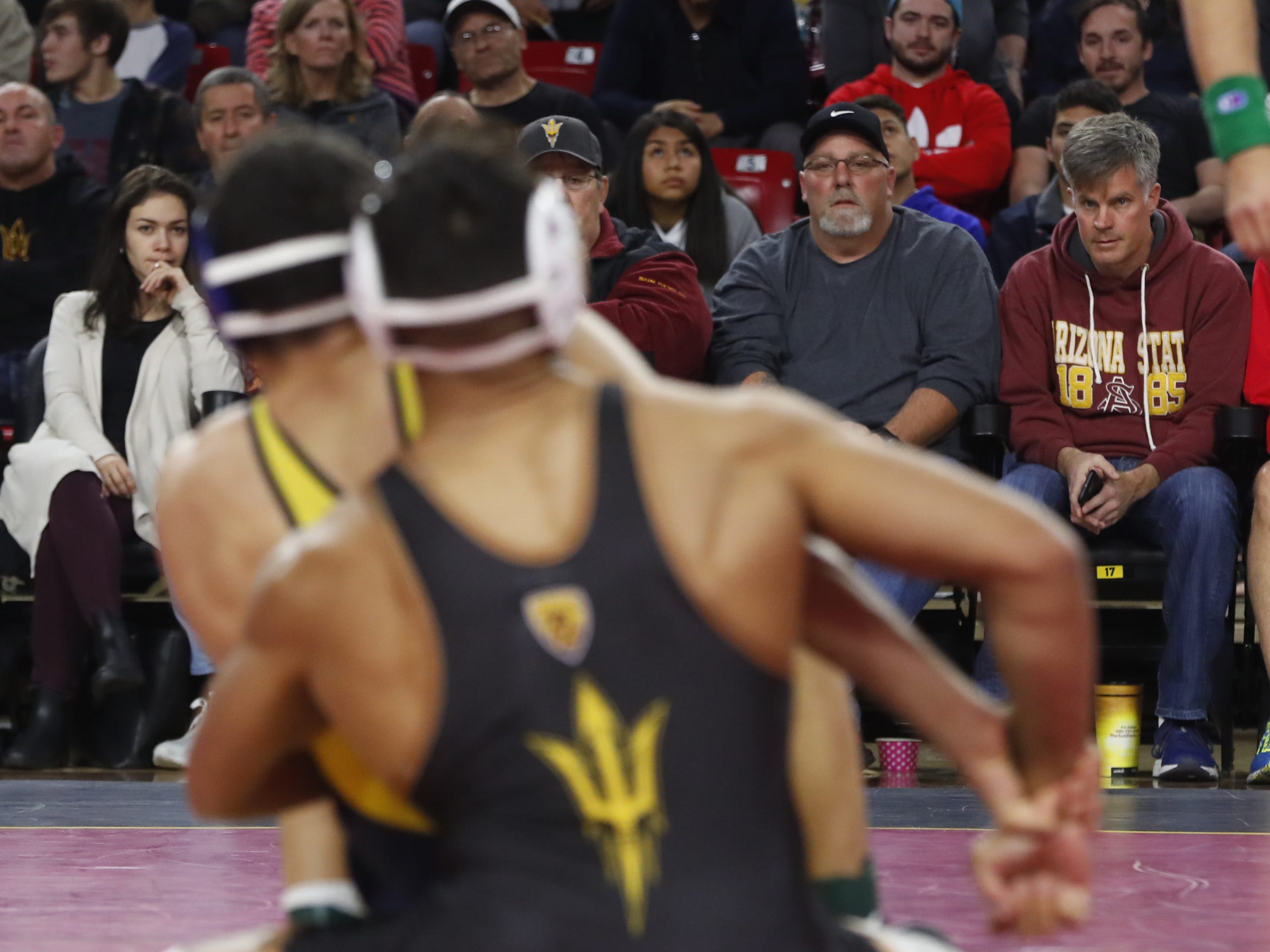 ASU's Zahid Valencia (in black) wrestles Michigan's Myles Amine (in blue and yellow) during a 174 lbs match at Wells Fargo Arena in Tempe, Ariz. on January 5, 2019.