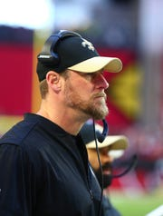 Saints assistant head coach/tight ends coach Dan Campbell looks on from the sideline during a game against the Cardinals on Dec. 16, 2016.