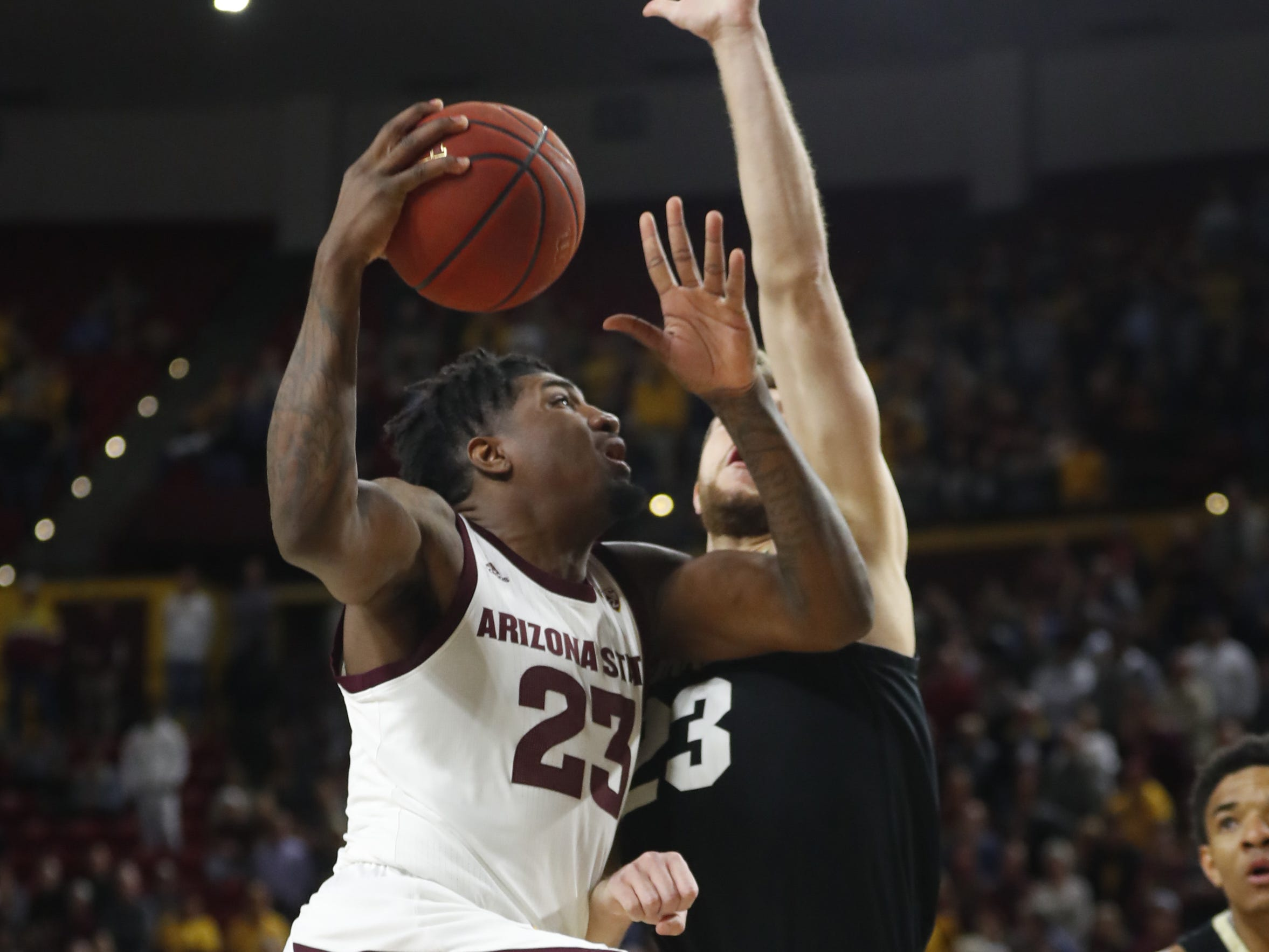 ASU's Romello White (23) shoots against Colorado's Lucas Siewert (23) during the first half at Wells Fargo Arena in Tempe, Ariz. on January 5, 2019.