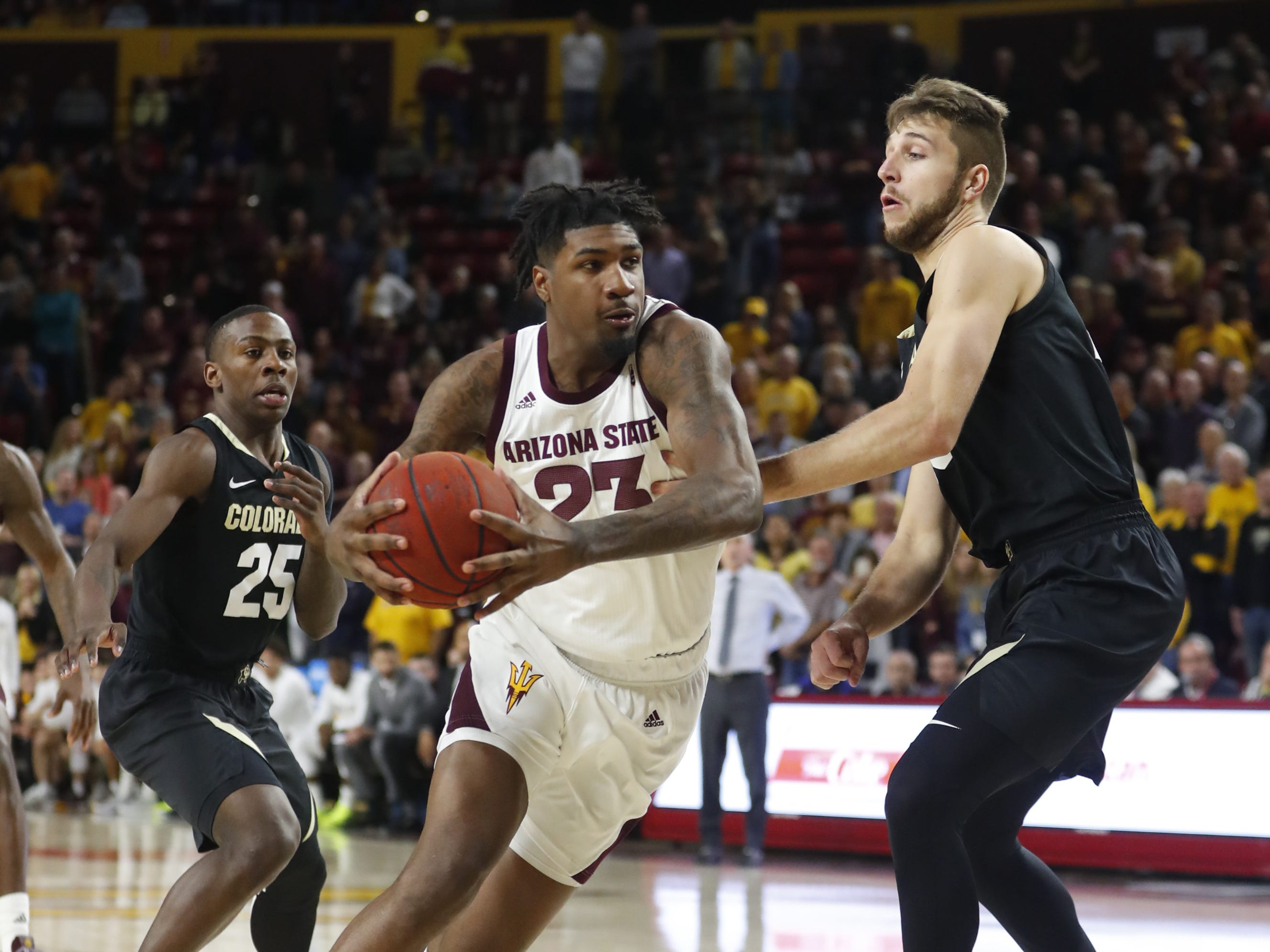 ASU's Romello White (23) drives against Colorado's Lucas Siewert (23) during the first half at Wells Fargo Arena in Tempe, Ariz. on January 5, 2019.
