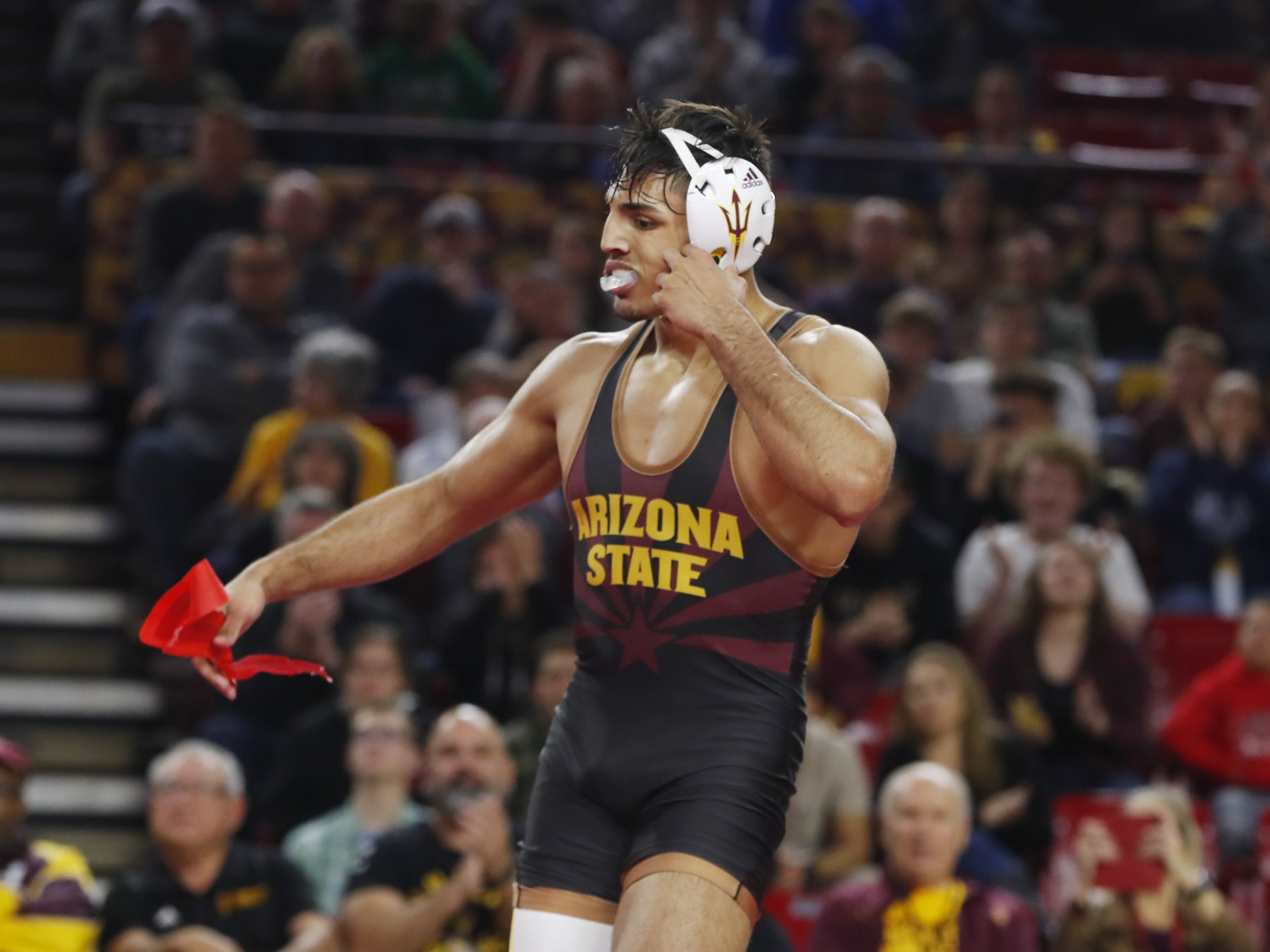 ASU's Zahid Valencia (in black) reacts to beating Michigan's Myles Amine (in blue and yellow) during a 174 lbs match at Wells Fargo Arena in Tempe, Ariz. on January 5, 2019.