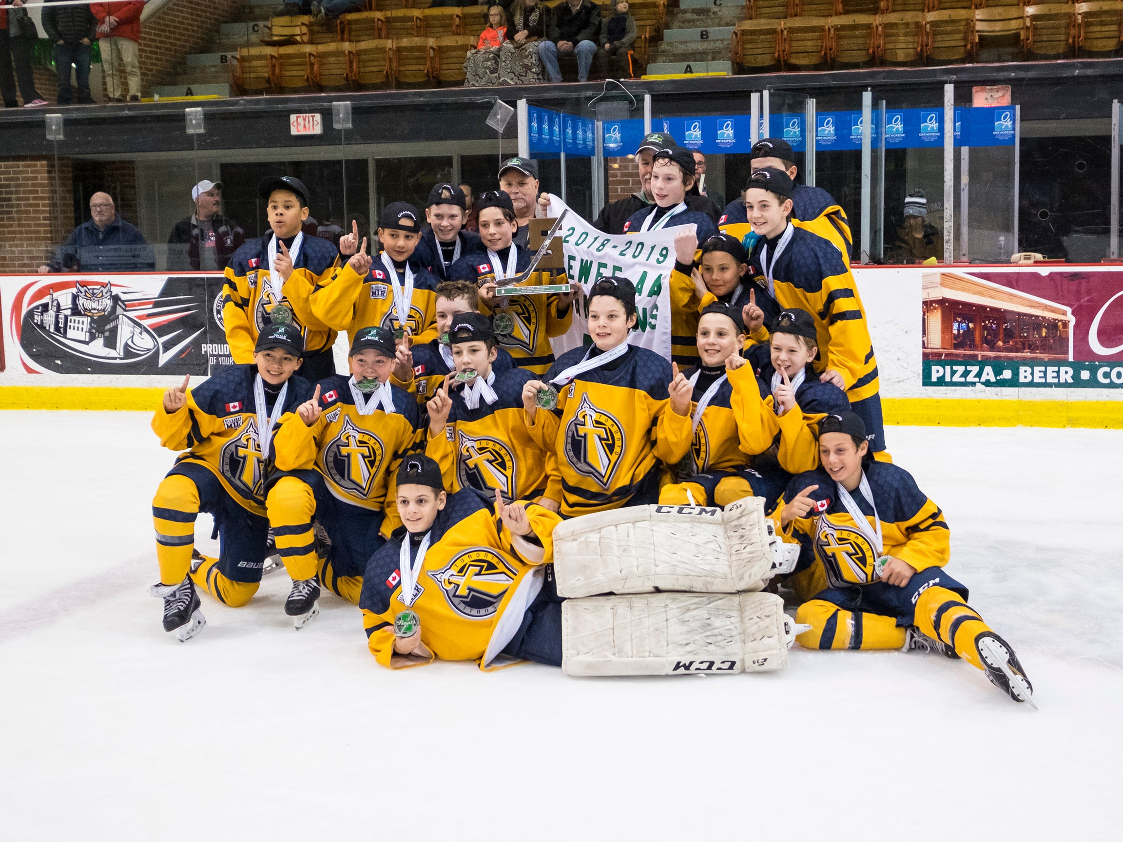 The Toronto Titans celebrate a 5-4 win in double overtime against Chicago Fury in the Silver Stick Finals PAAA Championship match Sunday, Jan. 6, 2019 at McMorran Arena.
