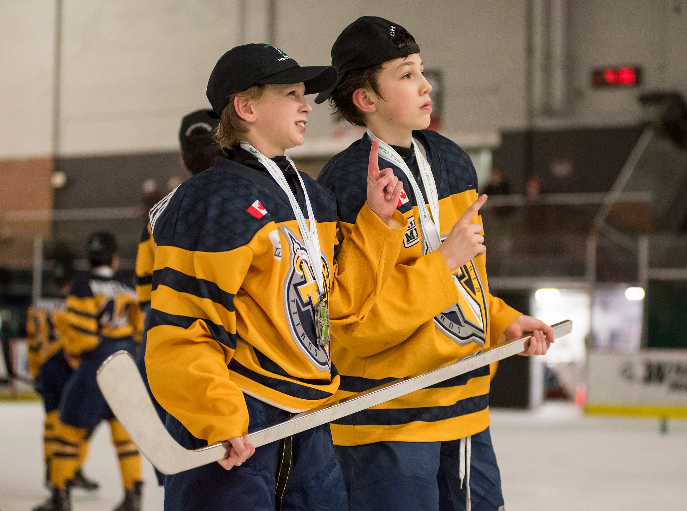 Toronto Titans forwards Nash Giles (right) and Nicholas Wellenreiter pose for photos with the Silver Stick after their team defeated Chicago Fury 5-4 in double overtime in the Silver Stick Finals PAAA Championship match Sunday, Jan. 6, 2019 at McMorran Arena.