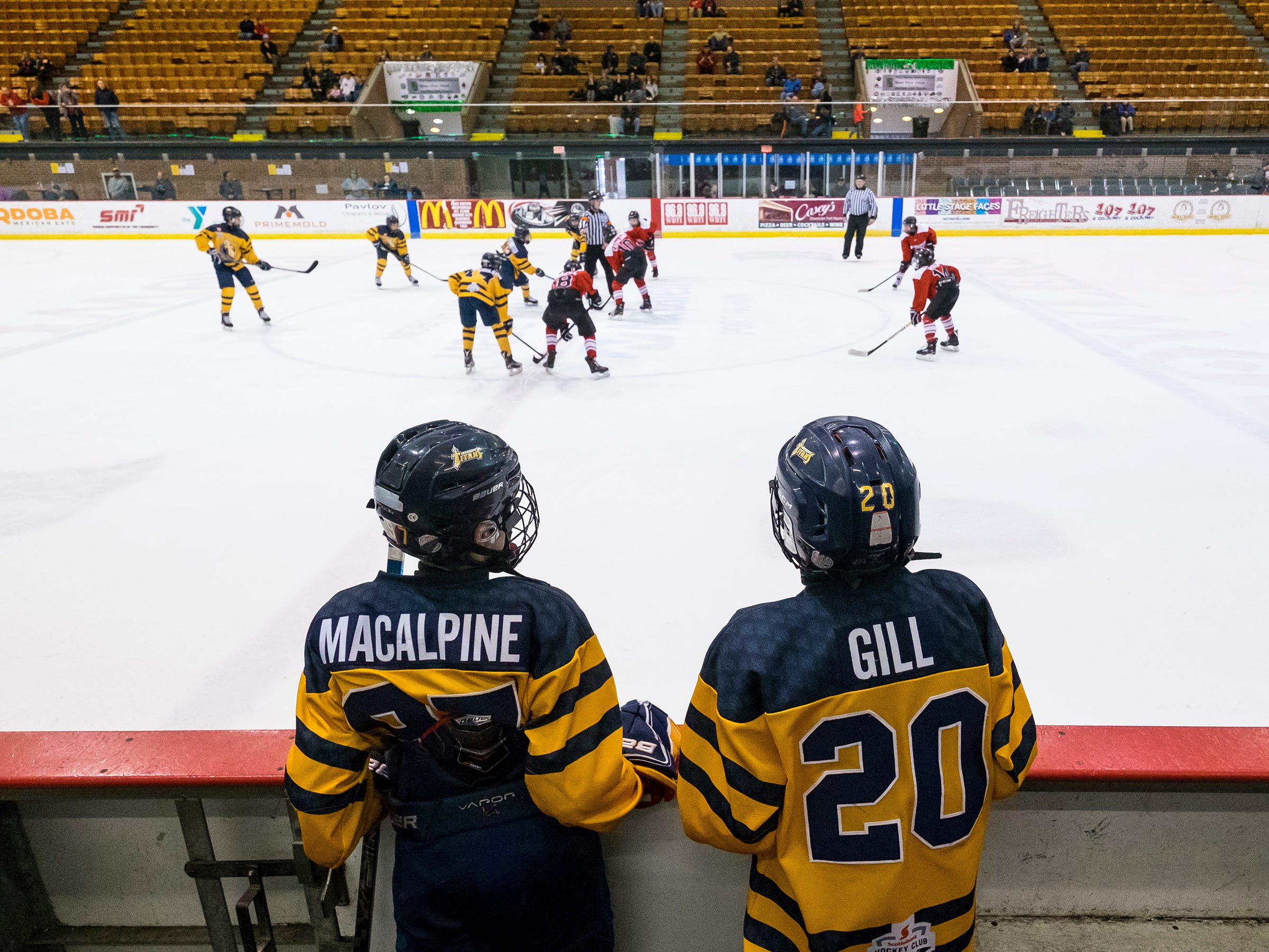 Toronto Titans defenseman Mack MacApline and Hudson Gill watch from the team box during the Silver Stick Finals PAAA Championship match against Chicago Fury Sunday, Jan. 6, 2019 at McMorran Arena.