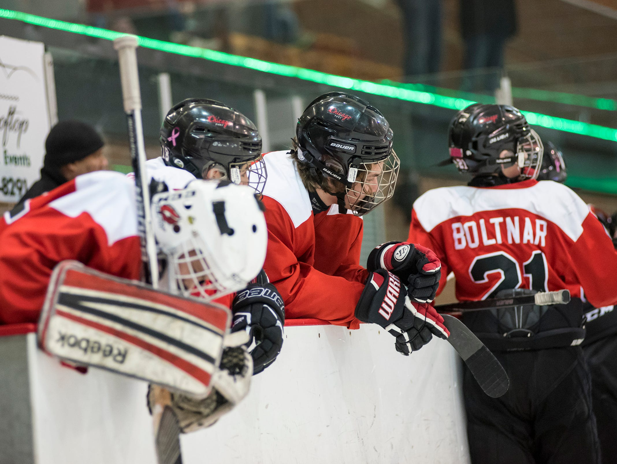 Chicago Fury players watch the Toronto Titans celebrate a 5-4 win in double overtime during the Silver Stick Finals PAAA Championship match Sunday, Jan. 6, 2019 at McMorran Arena.