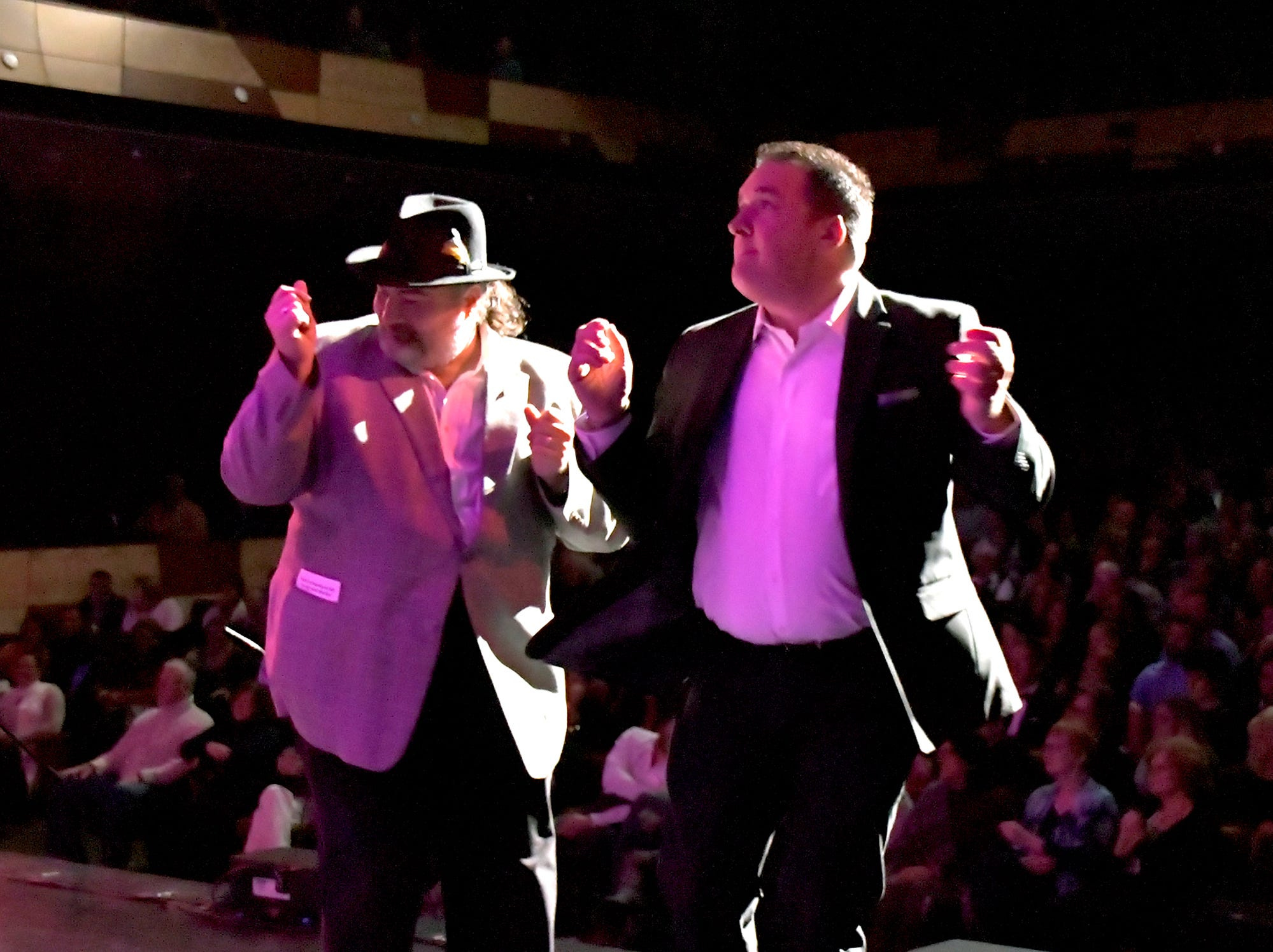 Doug Knight, left, dances on stage with Adam McCallister during a recent Peter Bottros concert at The Pullo Center. Knight died Friday, Jan. 4, 2019.