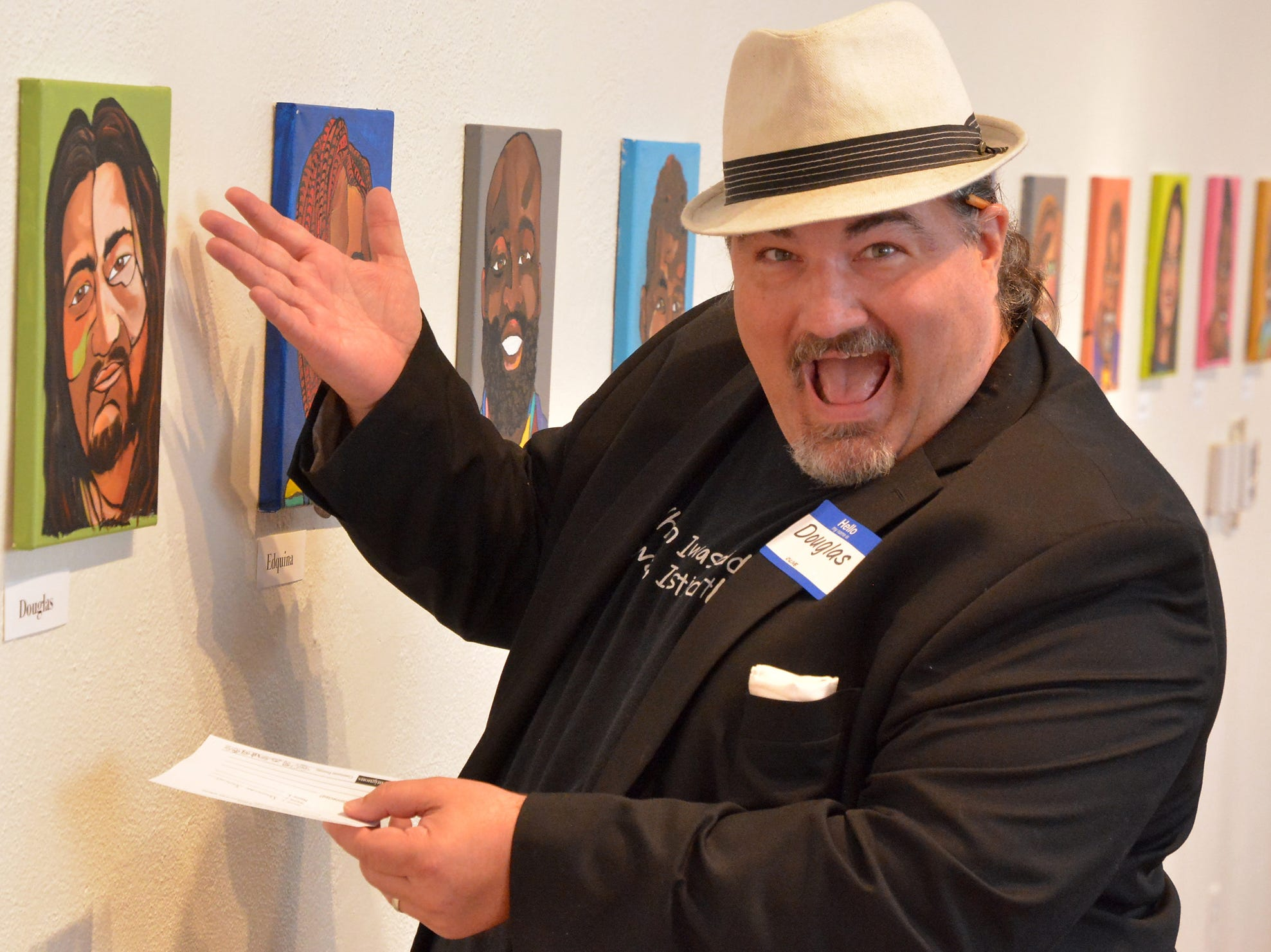"Doug Knight poses with a portrait of himself at artist Ophelia Chambliss' art show ""Contiguous"" at Marketview Arts. Knight died Friday, Jan. 4, 2019."