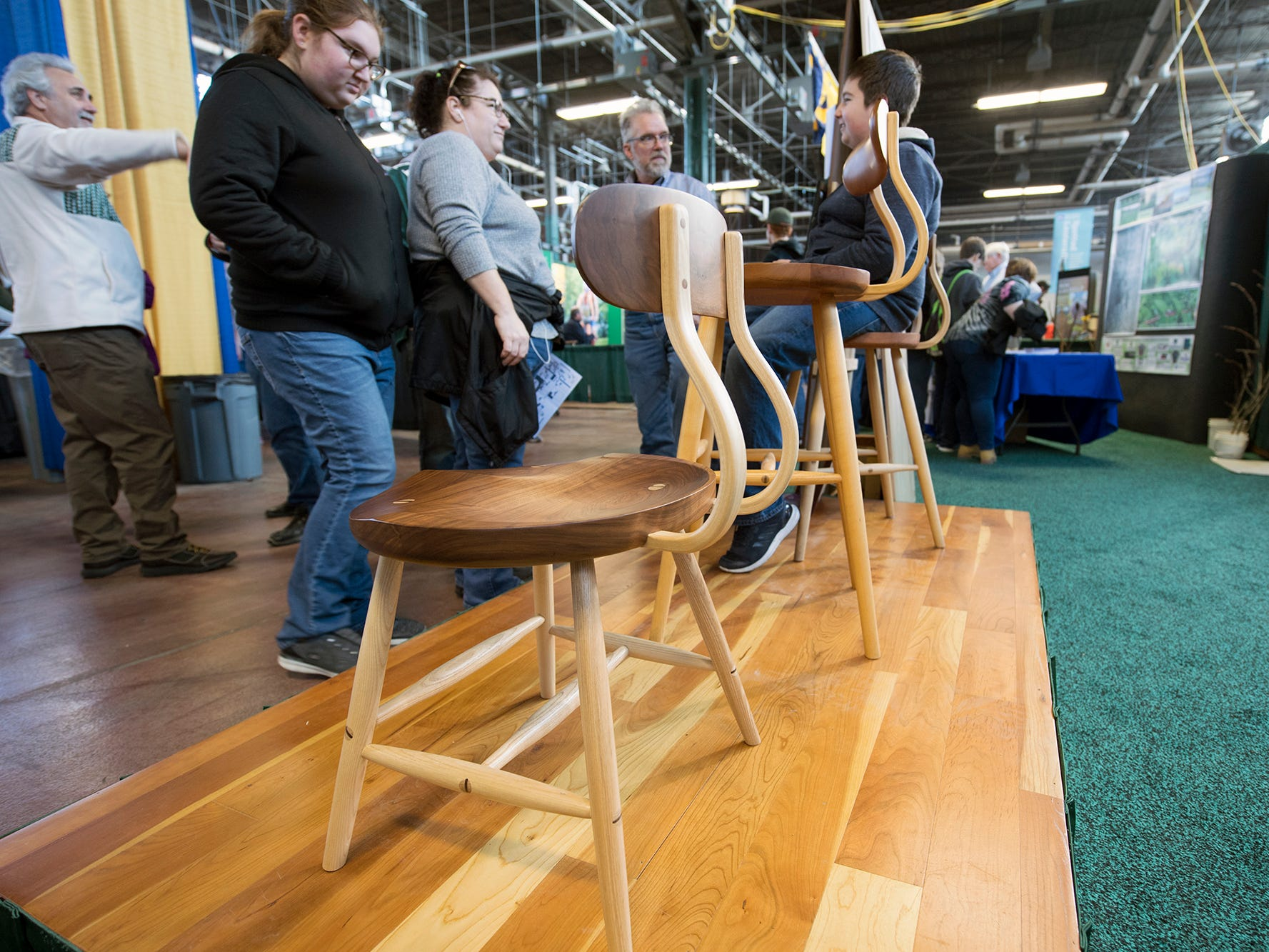 Interesting wooden chairs on display at the Pennsylvania Hardwood display during The 103rd Pennsylvania Farm Show in Harrisburg Sunday January 6, 2019.