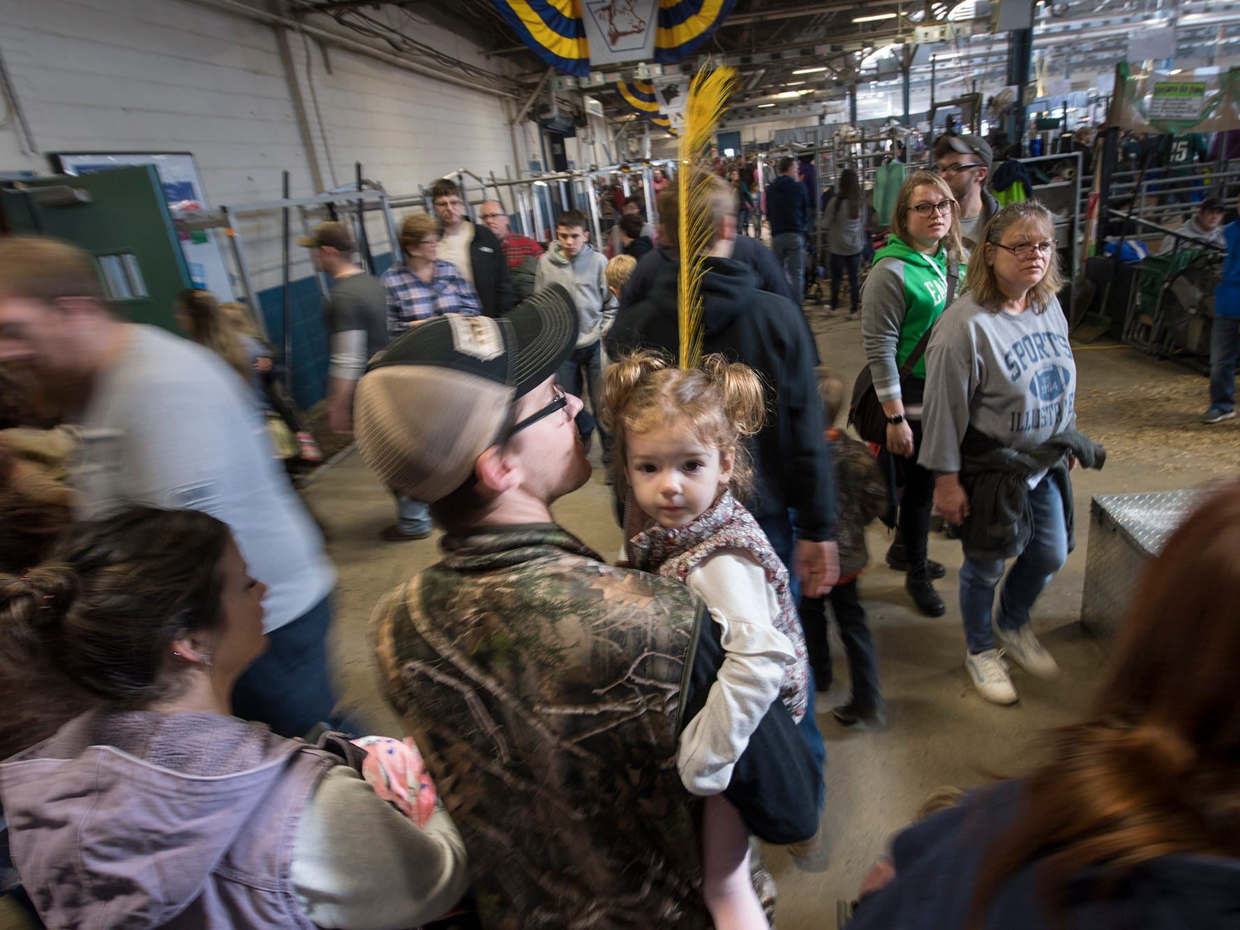Crowds work their way through the maze of buildings Sunday during The 103rd Pennsylvania Farm Show in Harrisburg.