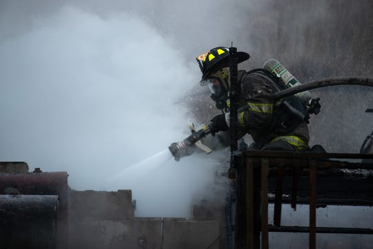 Firefighters work at the scene of a well-involved working house fire on the 200 block of Waldheim Rd., early Sunday, Jan. 6, 2019, in Hamilton Township. Hampton Fire Chief P.J. Trimmer said that the sole occupant of the house was able to escape safely with his dog, and there were no injuries in the fire. The house, which collapsed into the basement, is a total loss, and the detached garage suffered extensive damage, said Trimmer.