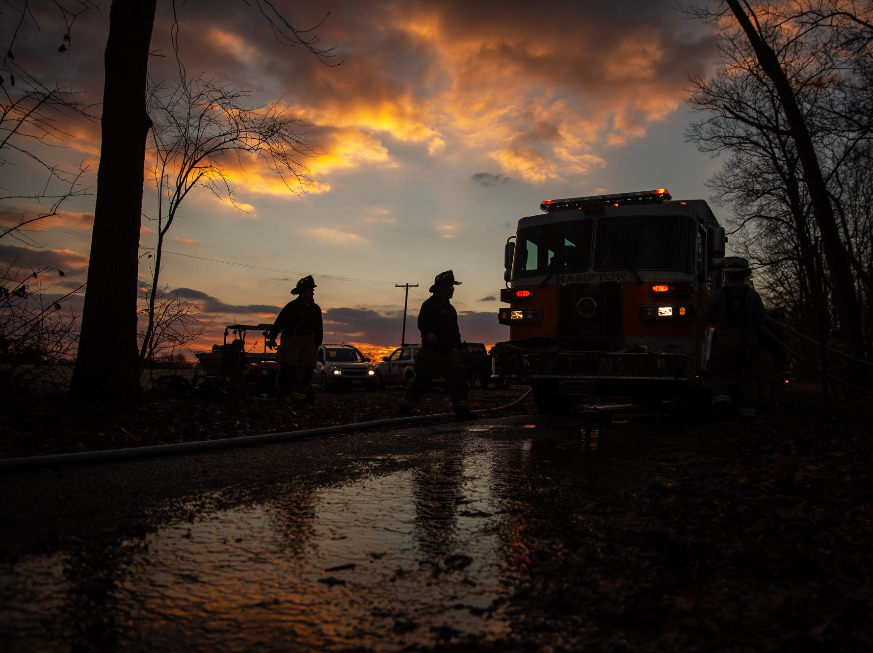 The sun begins to rise as firefighters work at the scene of a well-involved working house fire on the 200 block of Waldheim Rd., early Sunday, Jan. 6, 2019, in Hamilton Township. Hampton Fire Chief P.J. Trimmer said that the sole occupant of the house was able to escape safely with his dog, and there were no injuries in the fire. The house, which collapsed into the basement, is a total loss, and the detached garage suffered extensive damage, said Trimmer.