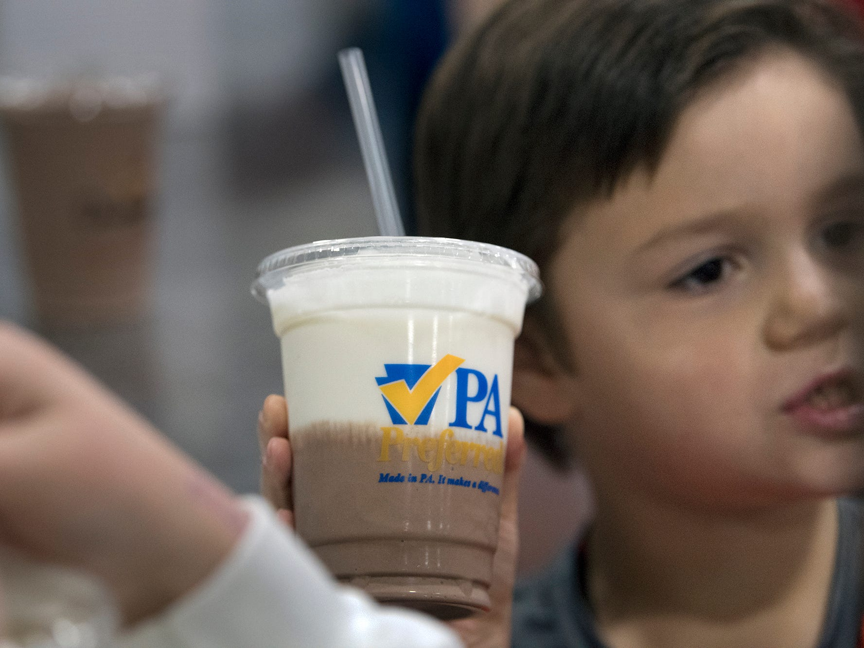A vanilla and chocolate milkshake is taken away from the counter at the food court during The 103rd Pennsylvania Farm Show in Harrisburg Sunday January 6, 2019.