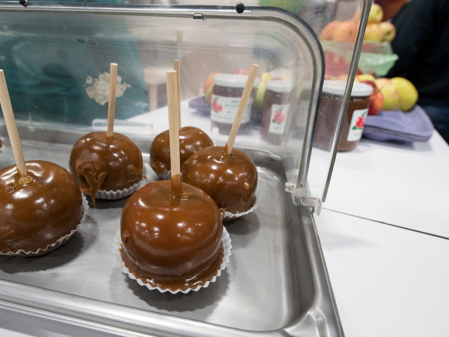 Caramel Pennsylvania apples ready to be eaten in the food court during The 103rd Pennsylvania Farm Show in Harrisburg Sunday January 6, 2019.