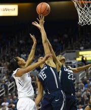 Nevada's Terae Briggs battles battles for a rebound against UConn's Gabby Williams (15) and Azura Stevens last season at Lawlor Events Center.